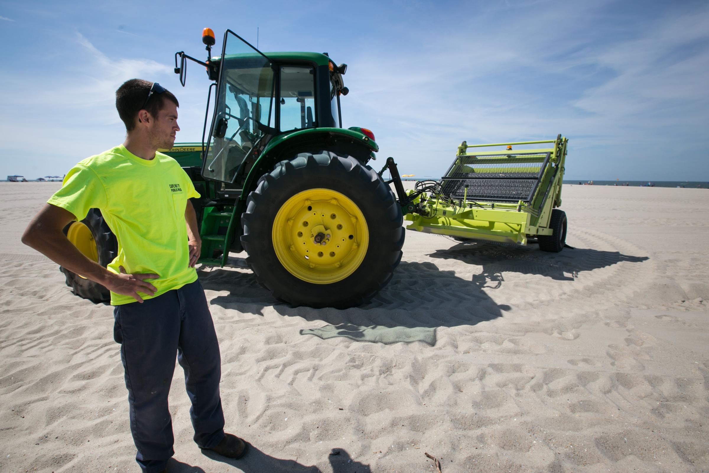 Heavy equipment operator Bryan Harron and the Cape May sandboni.