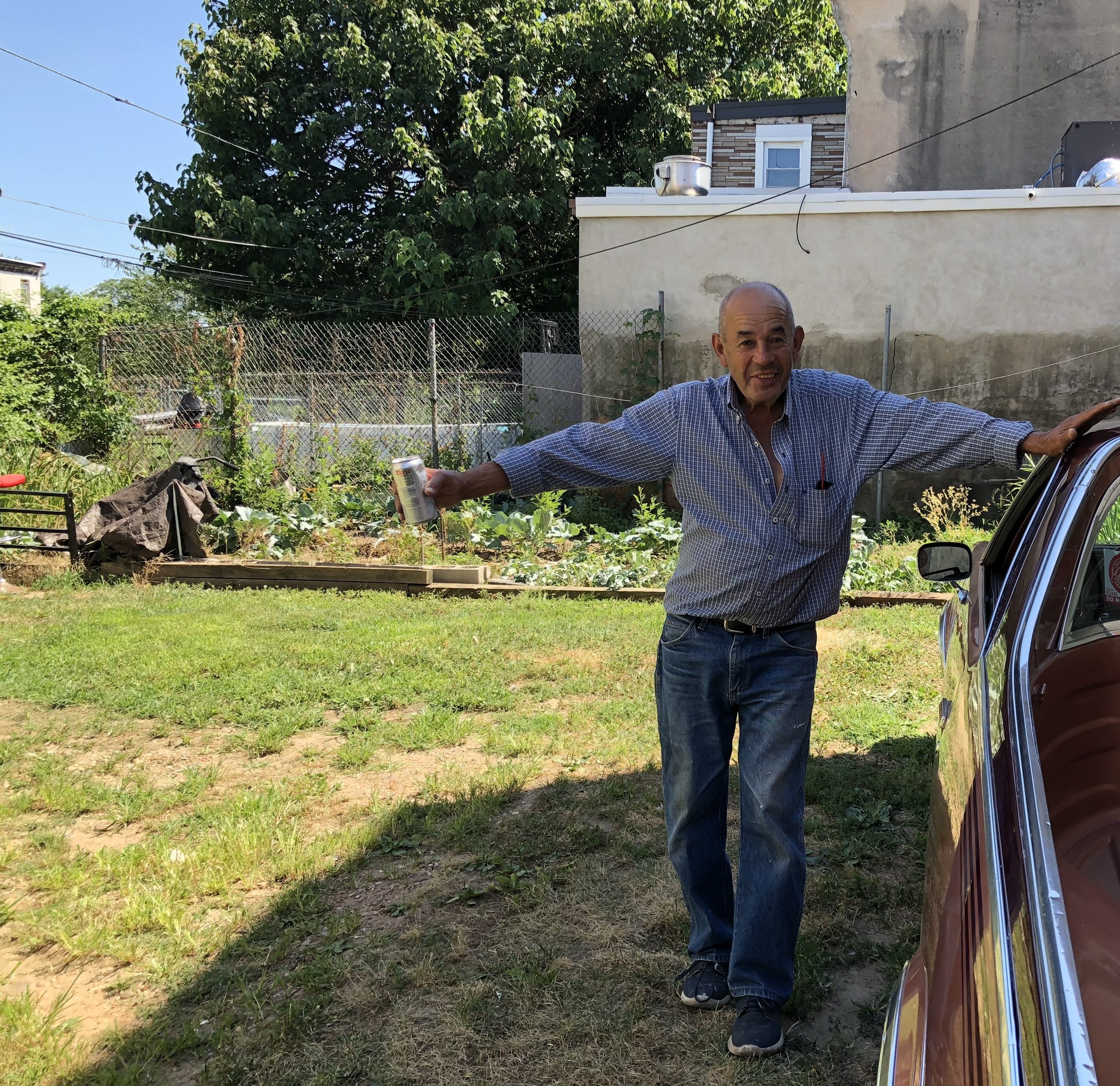 Since cleaning up a vacant lot in North Philadelphia, Rafael Martinez uses it to chat and drink beer with friends, and to plant a garden.