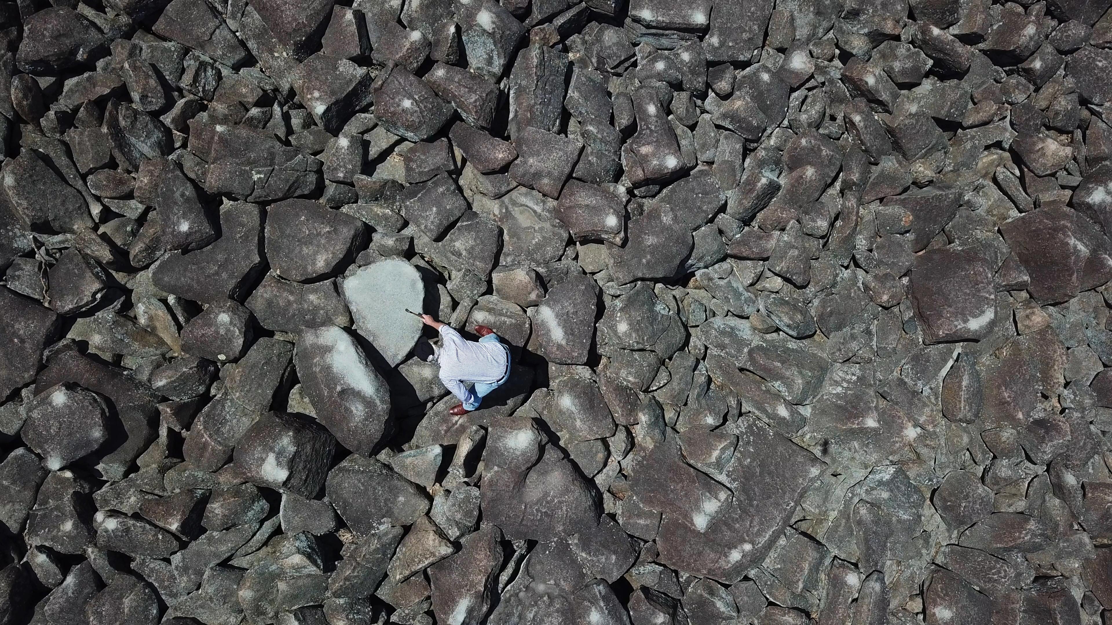 Curtis Nolley, 64, Harrisonburg, VA explores the ringing rocks of Upper Black Eddystone Thursday July 12, 2017. DAVID SWANSON / Staff Photographer .