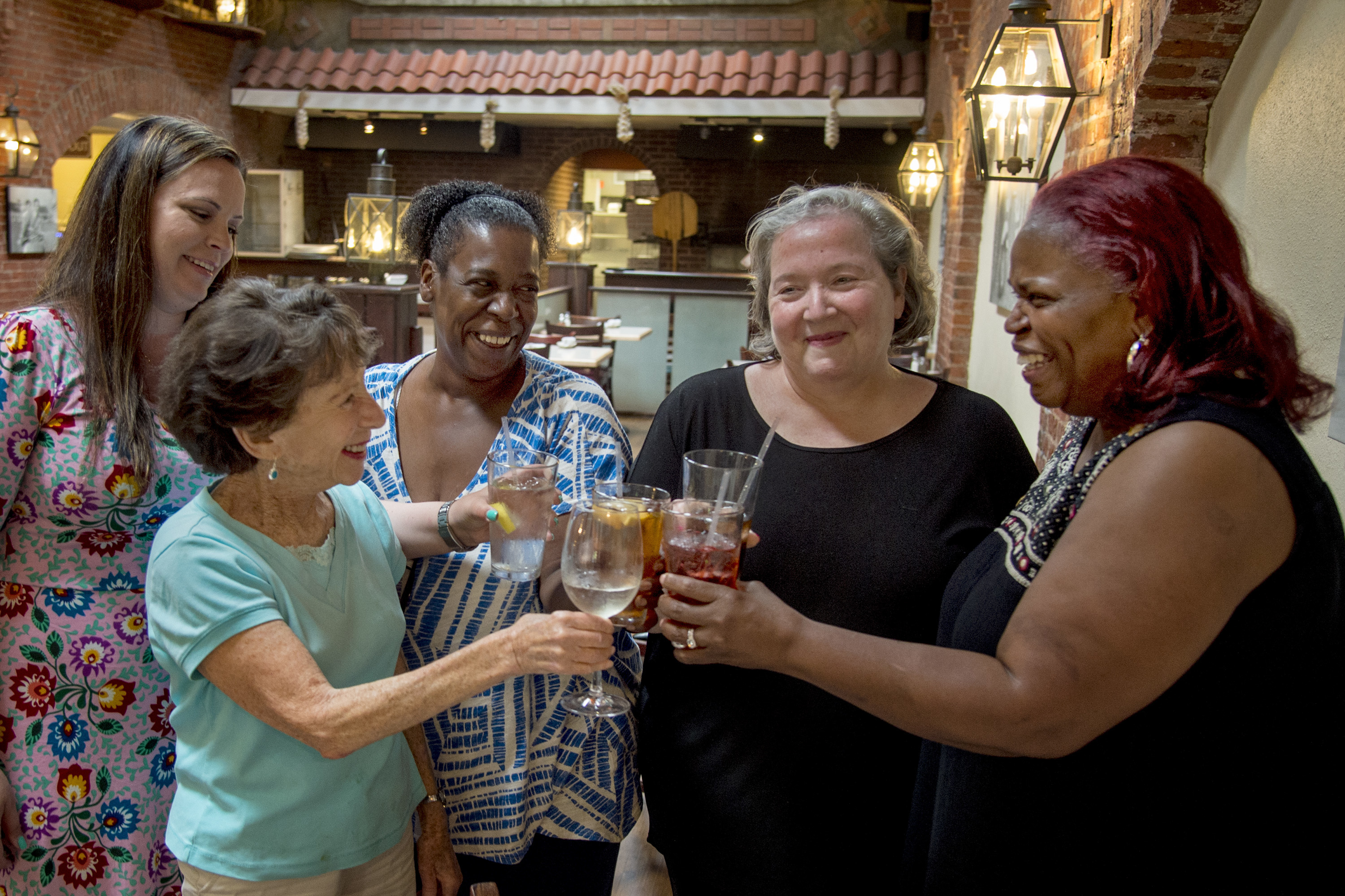 Ruth Rovner (second from left) toasts a group of older beneficiaries of her scholarships at Community College of Philadelphia, as they get together for dinner at Pietro´s on South Street. Behind her, from left are: Victoria Phraner, Dawn Joiner, Deborah Fine and Rhonda Davis.