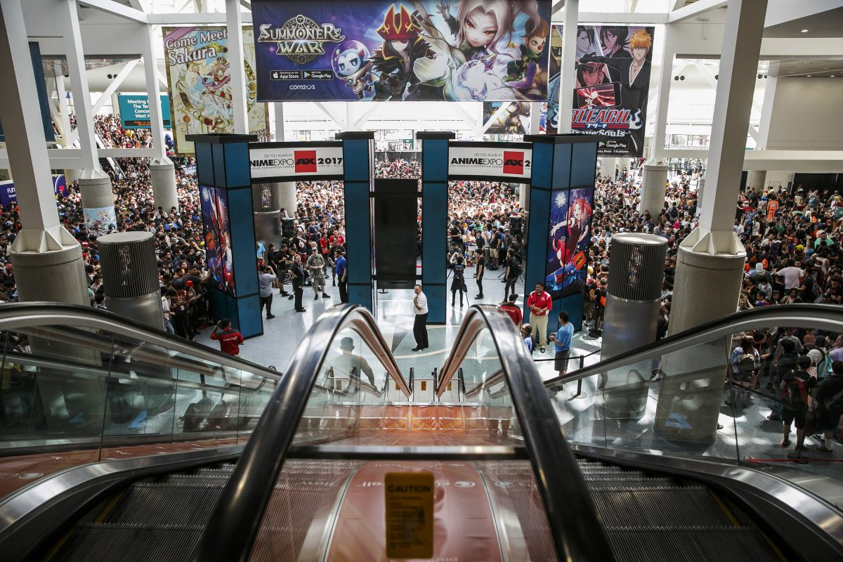 A huge crowd awaits the opening of the Anime Expo 2016, in Los Angeles, Calif.
