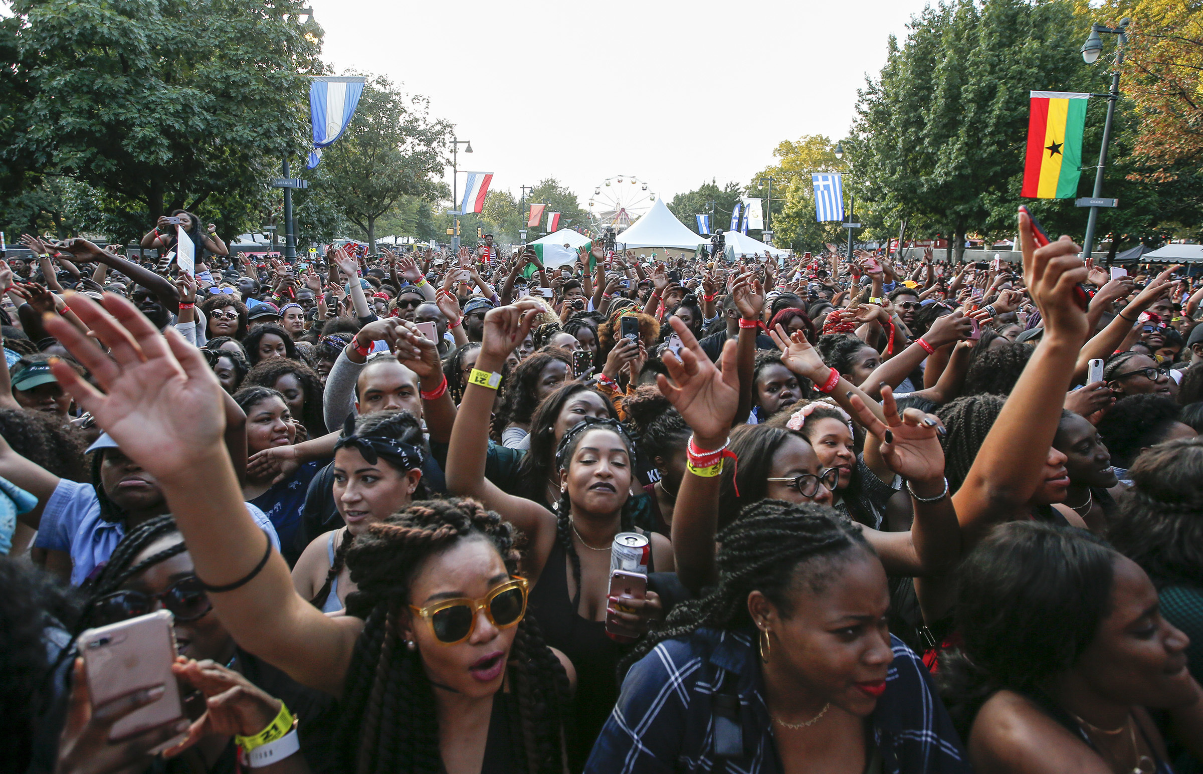 Fans wave their arms while Maleek Berry performed at the Tidal Stage during Made In America along the Benjamin Franklin Parkway on Sunday, September 3, 2017.