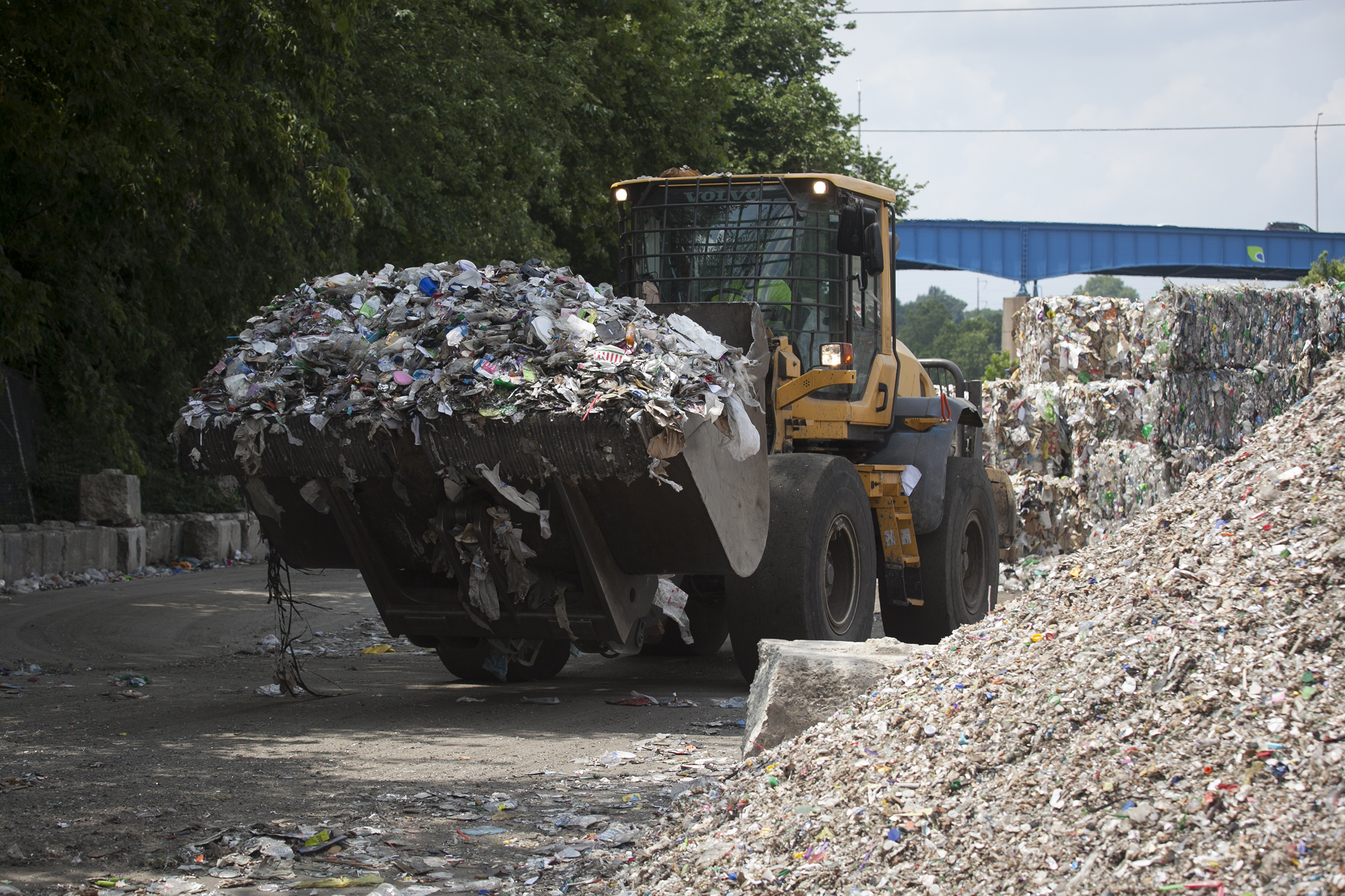A loader moves waste and recyclables at Republic Services