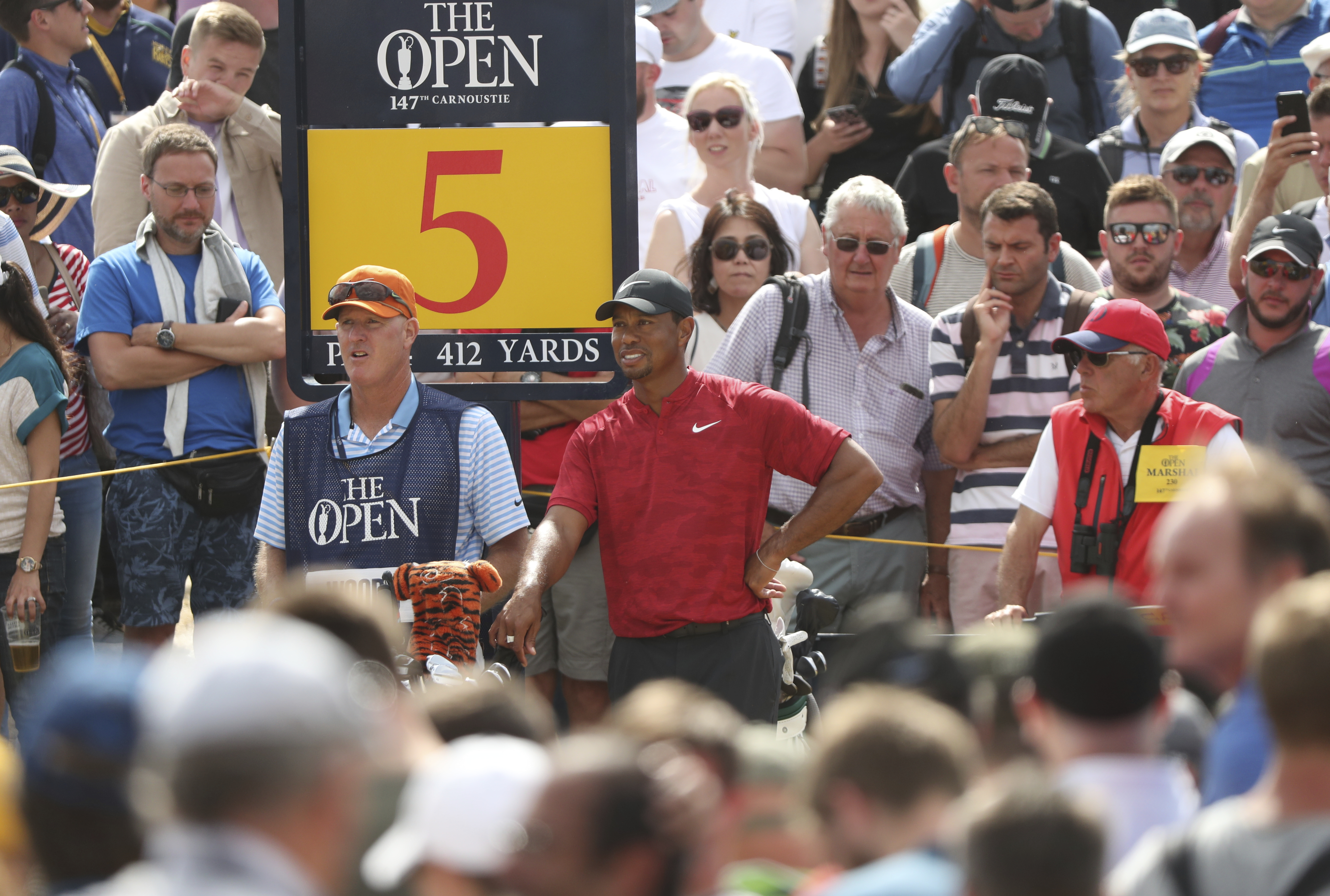 Tiger Woods prepares to play off the 5th tee during the final round of the British Open on Sunday.