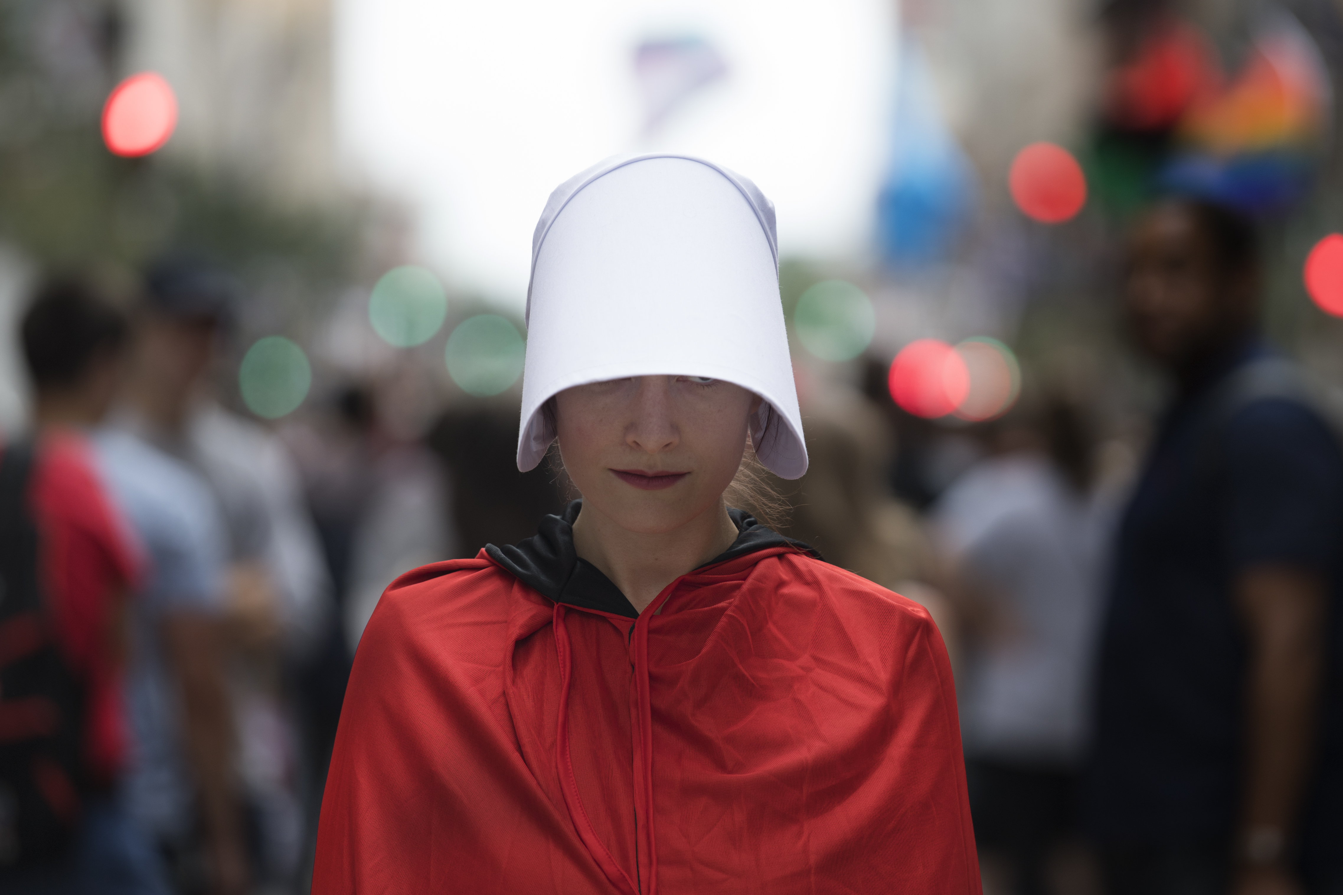 An unidentified woman protest at Broad Street for the pending arrival of Vice President Mike Pence at the Union League, in Philadelphia, Monday July 23, 2018.