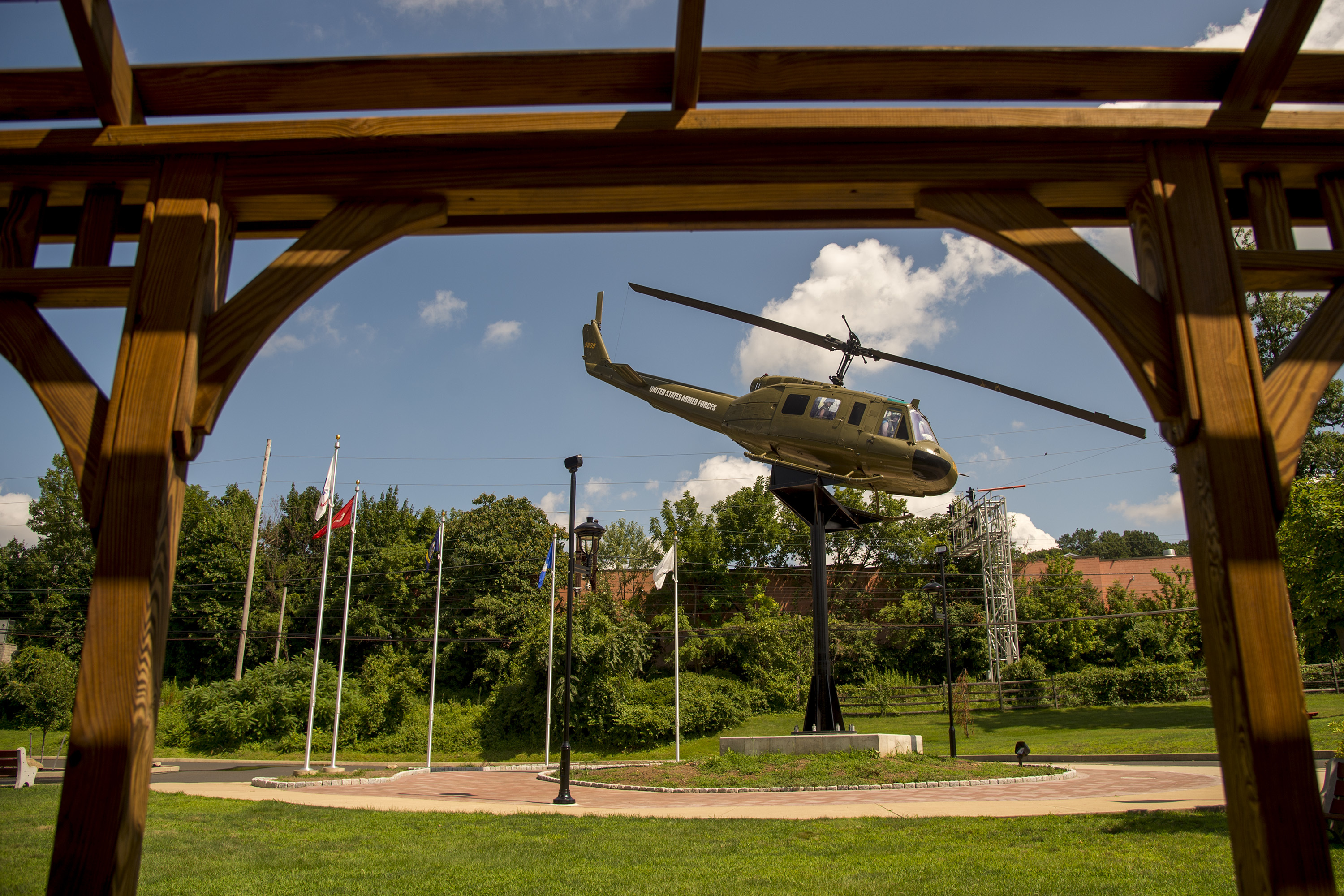 """An actual Vietnam War-era Bell UH-1 Iroquois """"Huey"""" helicopter in Willow Grove´s Veterans Memorial Park July 26, 2018. Ralph Storti, a Vietnam War veteran, spent fourteen years working to realize his vision of the memorial to honor members of all branches of the armed services. TOM GRALISH / Staff Photographer"""