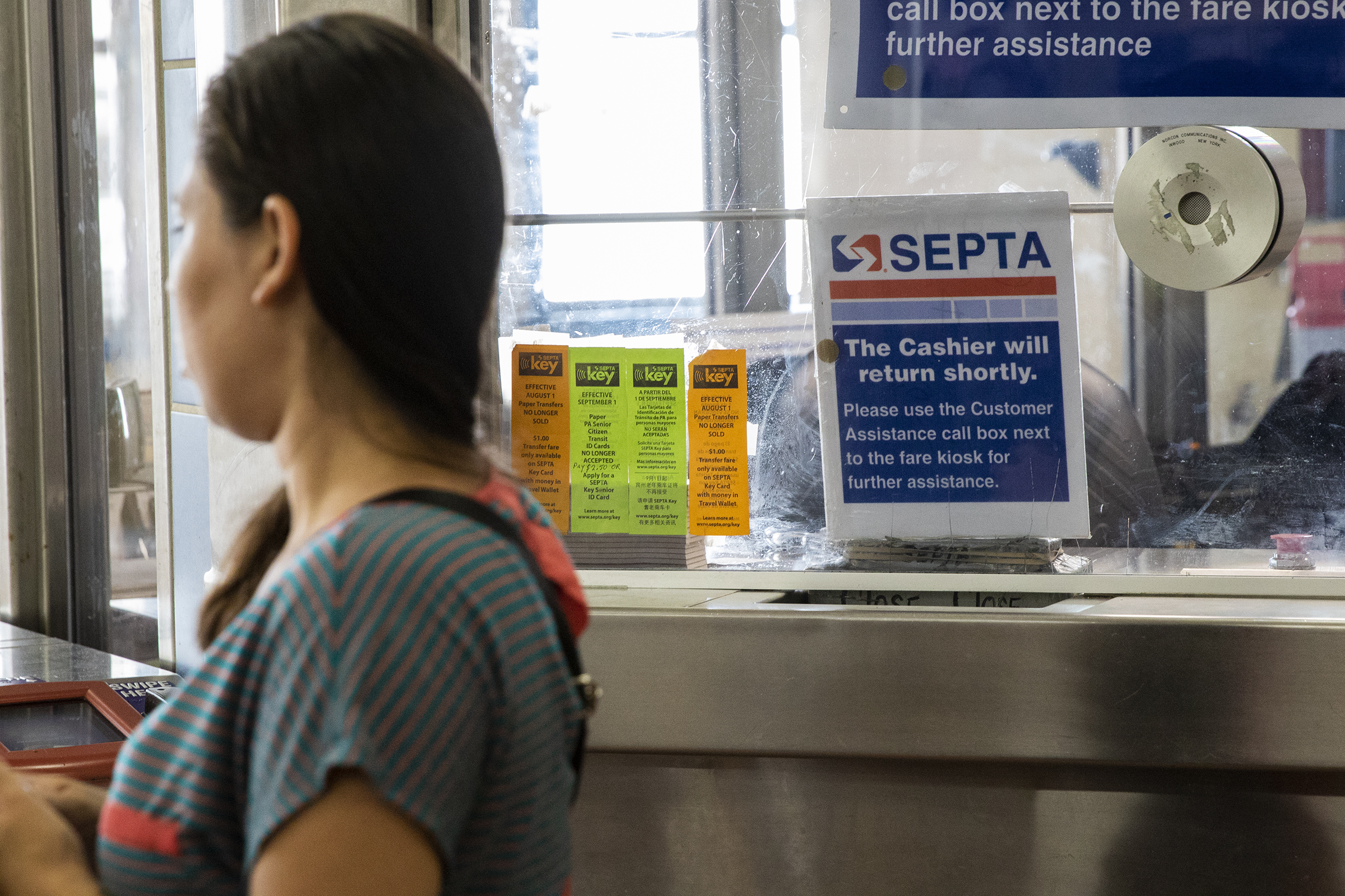 Commuters wait for a SEPTA cashier to take their paper transfer slips at the 69th Street Transportation Center in Upper Darby, on Thursday, July 26, 2018. SEPTA will no longer be selling paper transfers starting on Aug. 1. HEATHER KHALIFA / Staff Photographer
