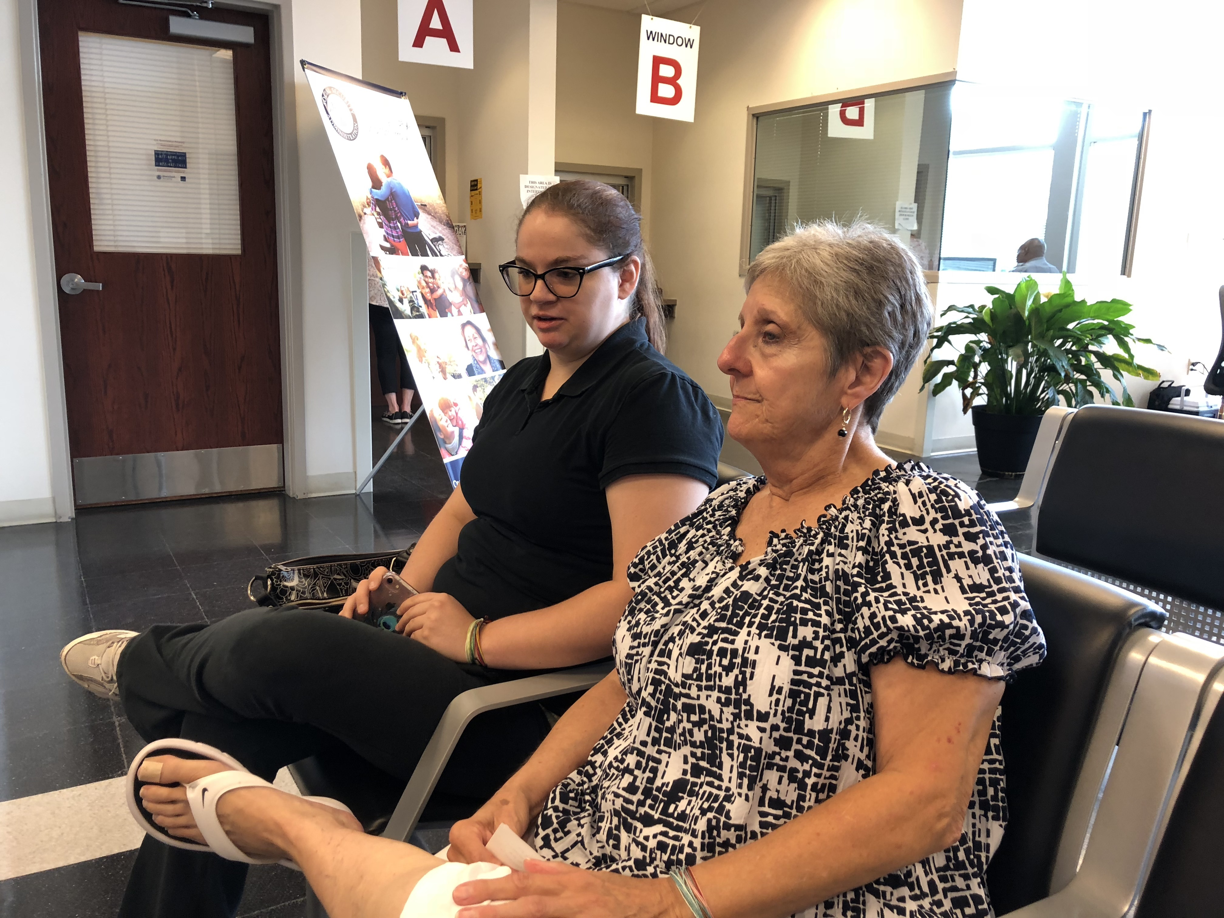 Susan Scott, with her granddaughter Taryn, waits her turn in the Social Security office in Limerick.