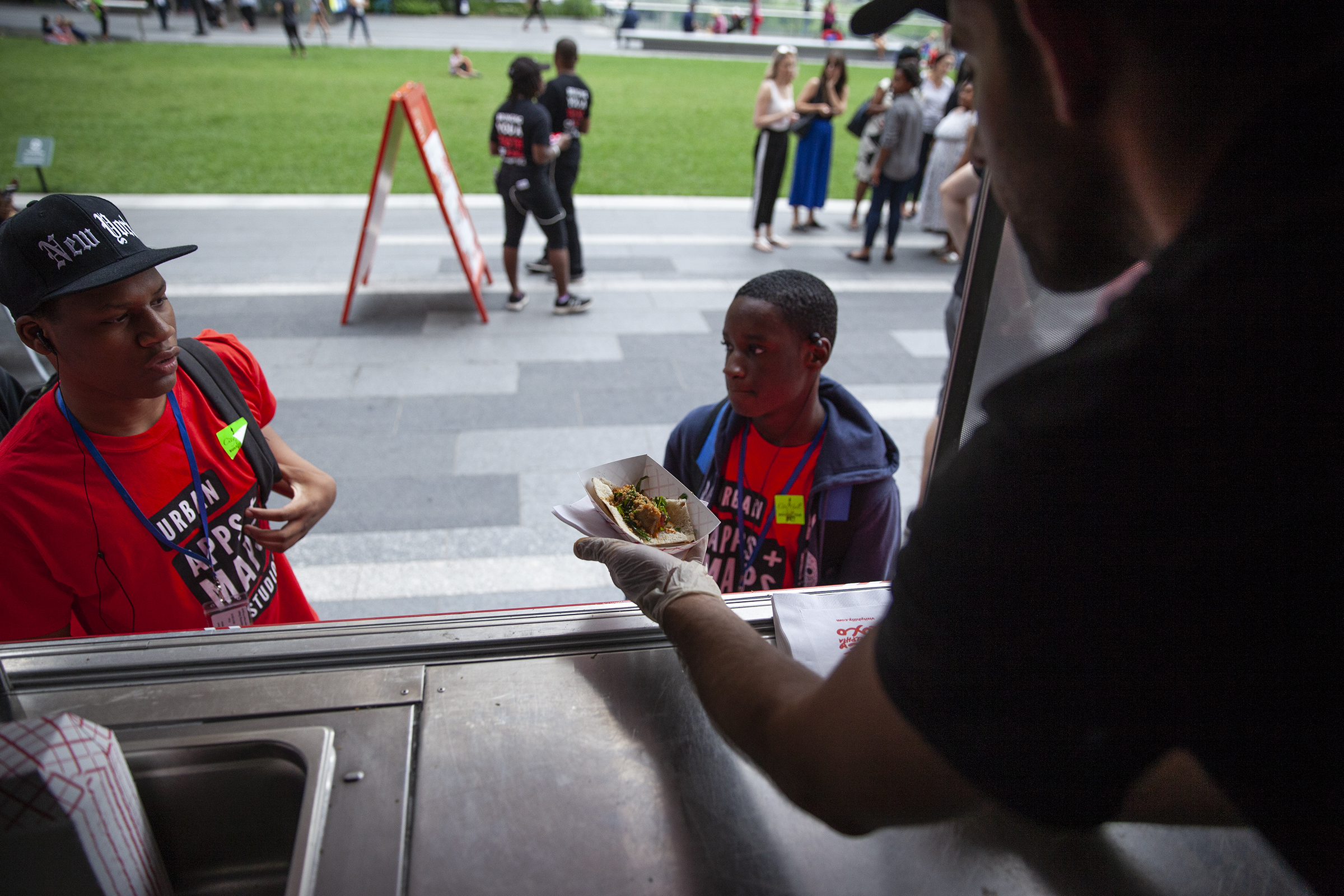 Anthony Strelzick serves food out of the Visit Philadelphia food truck parked in Dilworth Plaza at City Hall.