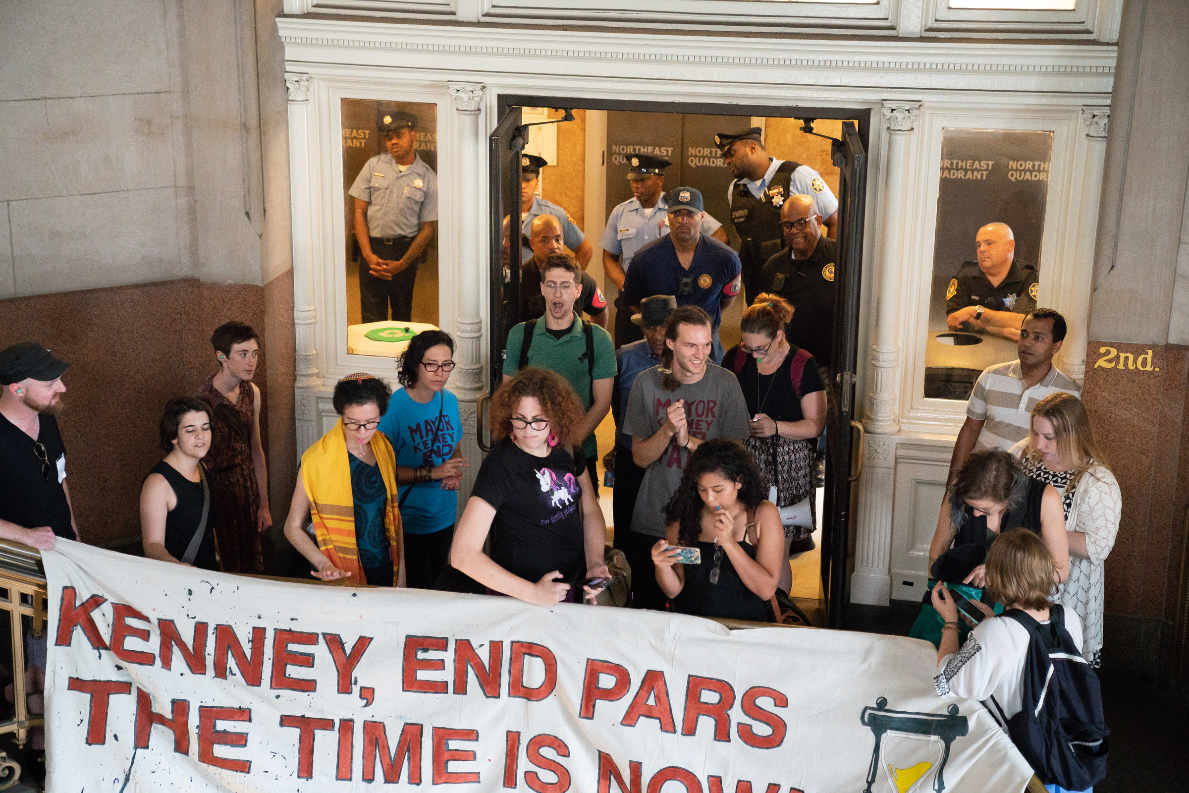 ICE Protestors block a door leading to the second floor of City Hall, in Philadelphia, on Wednesday.