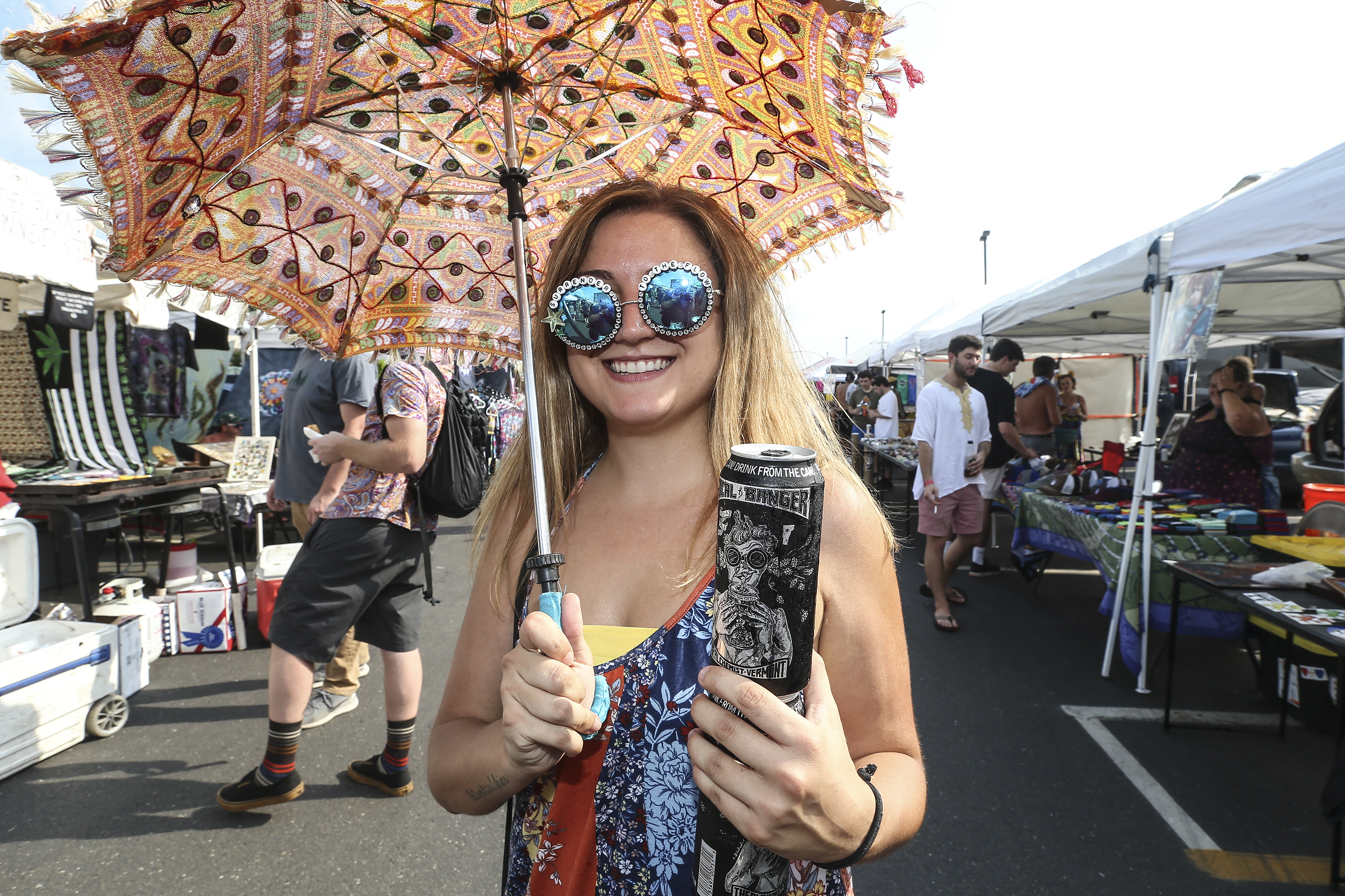 """Marlee Barbetto, 25 from Atlantic City strolls down """"Shakedown Street"""" in the Phish parking lot before the concert in Camden. Tuesday, August 7 , 2018 STEVEN M. FALK / Staff Photographer"""
