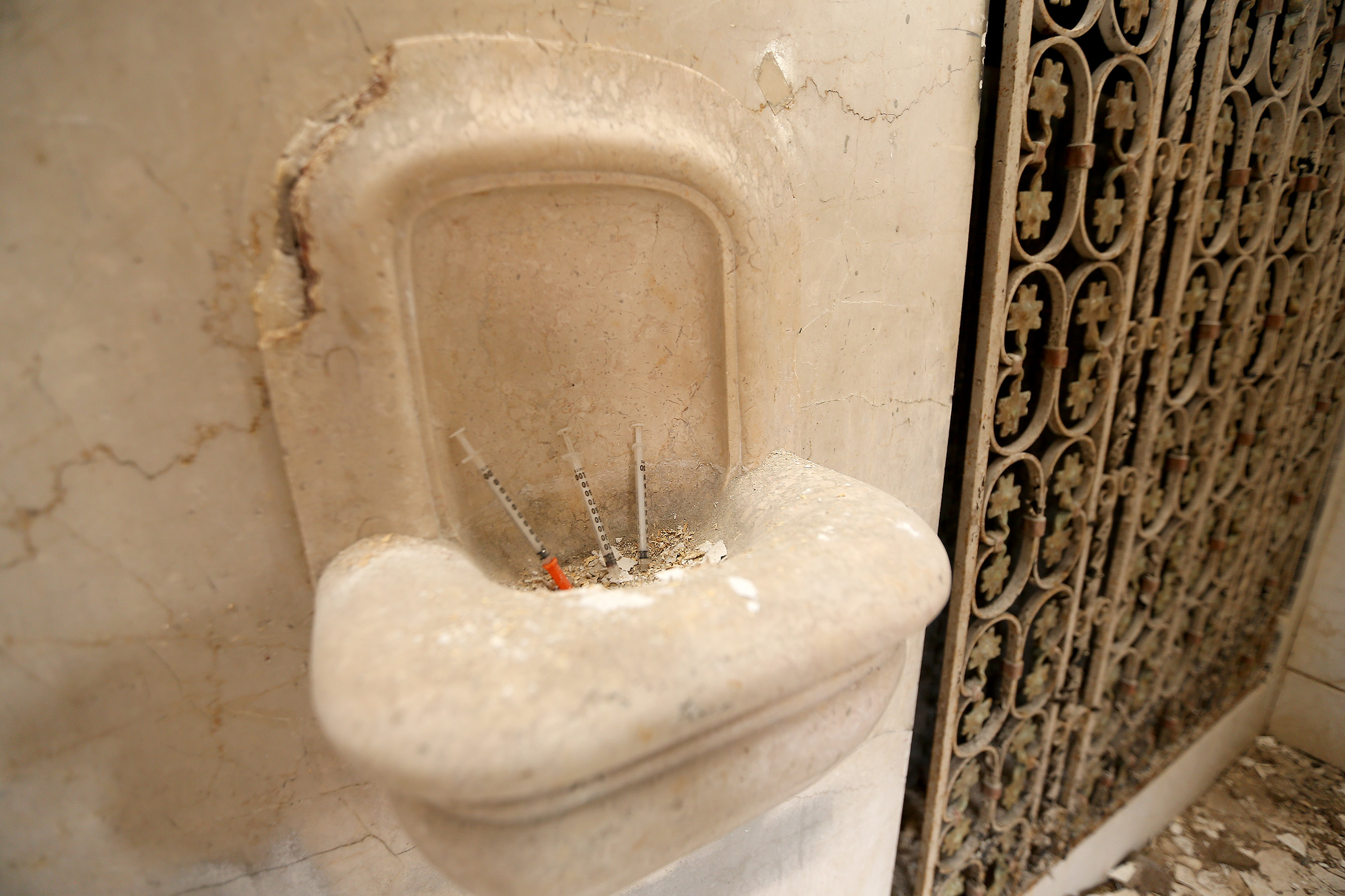 Three needles sit in what was a holy water basin inside the former Ascension of Our Lord church in Philadelphia, PA on July 5, 2017. DAVID MAIALETTI / Staff Photographer