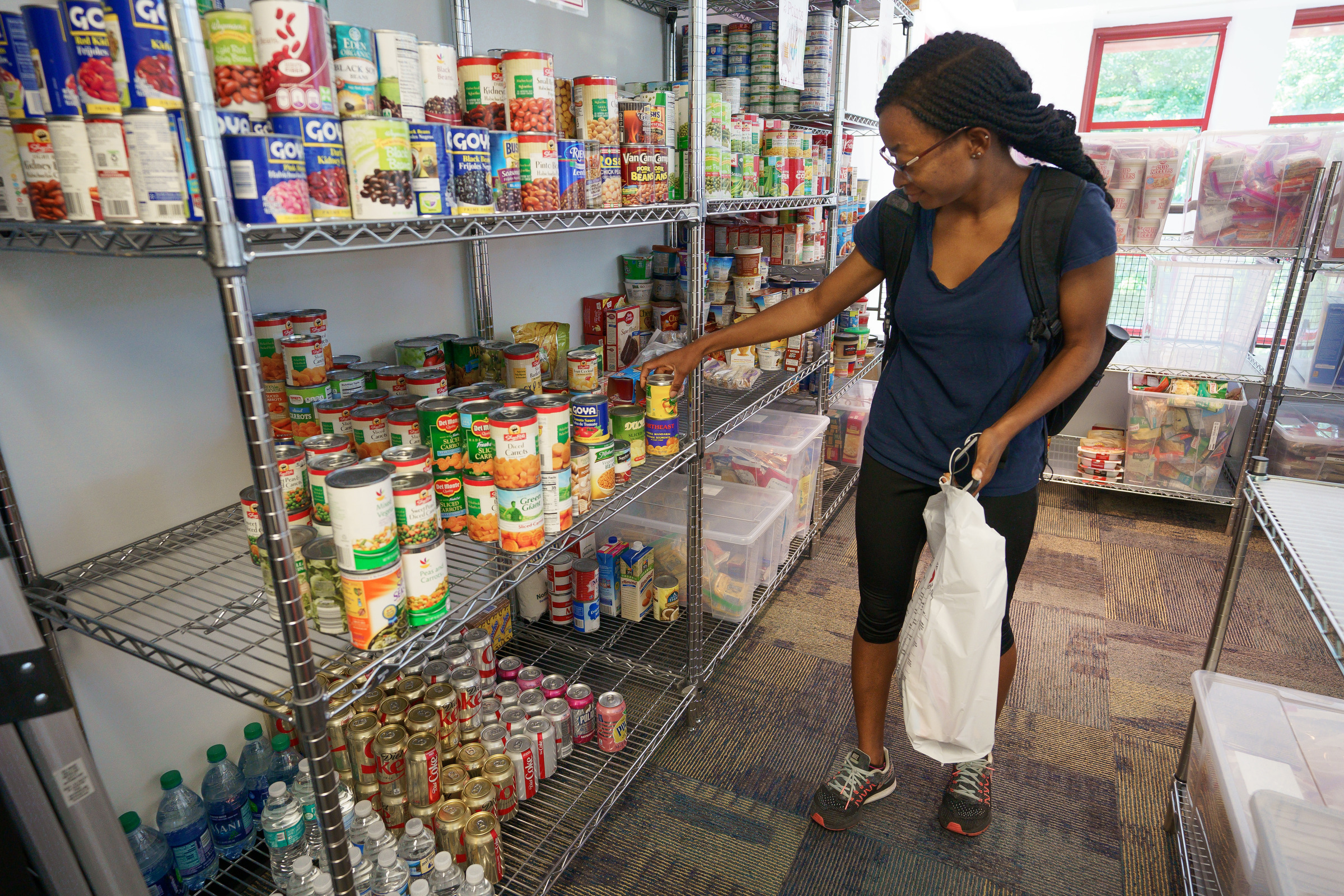 Graduate student Sharon Okune selects groceries at the Temple University food pantry, in Philadelphia, Thursday, August 09, 2018.