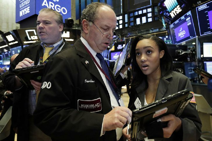 Lauren Simmons, 23, is the youngest female trader on the New York Stock Exchange. She spoke Tuesday, July 31, 2018 in Philadelphia, and is pictured here with Rosenblatt Securities partner Gordon Charlop, who hired Simmons in 2017. (Credit: AP)
