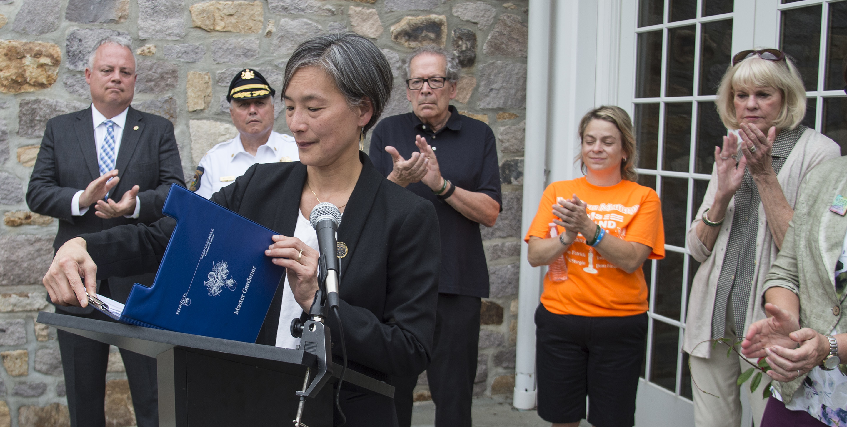 PA State Rep. Helen Tai (D-Bucks) closes her notes and receives a round of applause after she announced at a press conference at the Solebury Township Building July 31, 2018 that she will be introducing three gun safety bills into the legislature this fall. Others at the press conference are (from left) PA State Rep. Perry Warren (D - Bucks) — who is also reintroducing a universal gun background check bill — Solebury Township police chief Dominick Bellizzie, Rich Patrick, grandfather and legal guardian of Jimi Patrick, one of Cosmo DiNardo's victims, Melissa Fratanduono-Meo, mother of another DiNardo victim Tom Meo, and Sharon Patrick, Jimi Patrick�s grandmother.