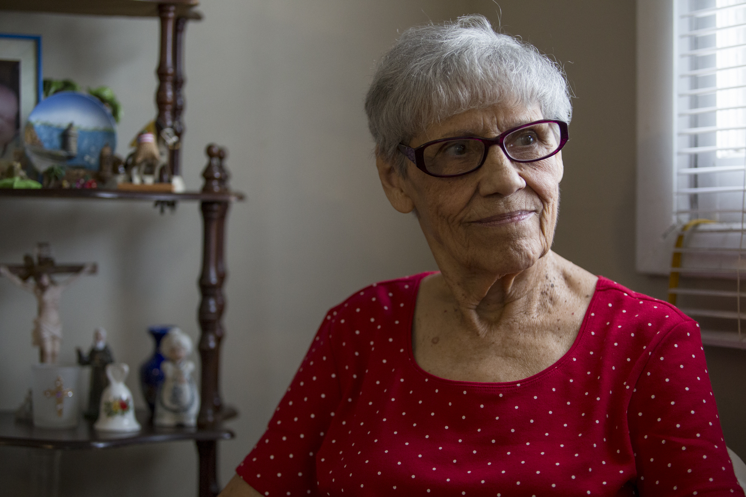 Lydia Braggs, 90, sits in her home in Camden July 7, 2017. Braggs and her sister, Libby Velazquez, started the first Spanish speaking worship service at St. Anthony´s church in Camden, which is being merged with St. Joseph´s Pro- Cathedral in East Camden.