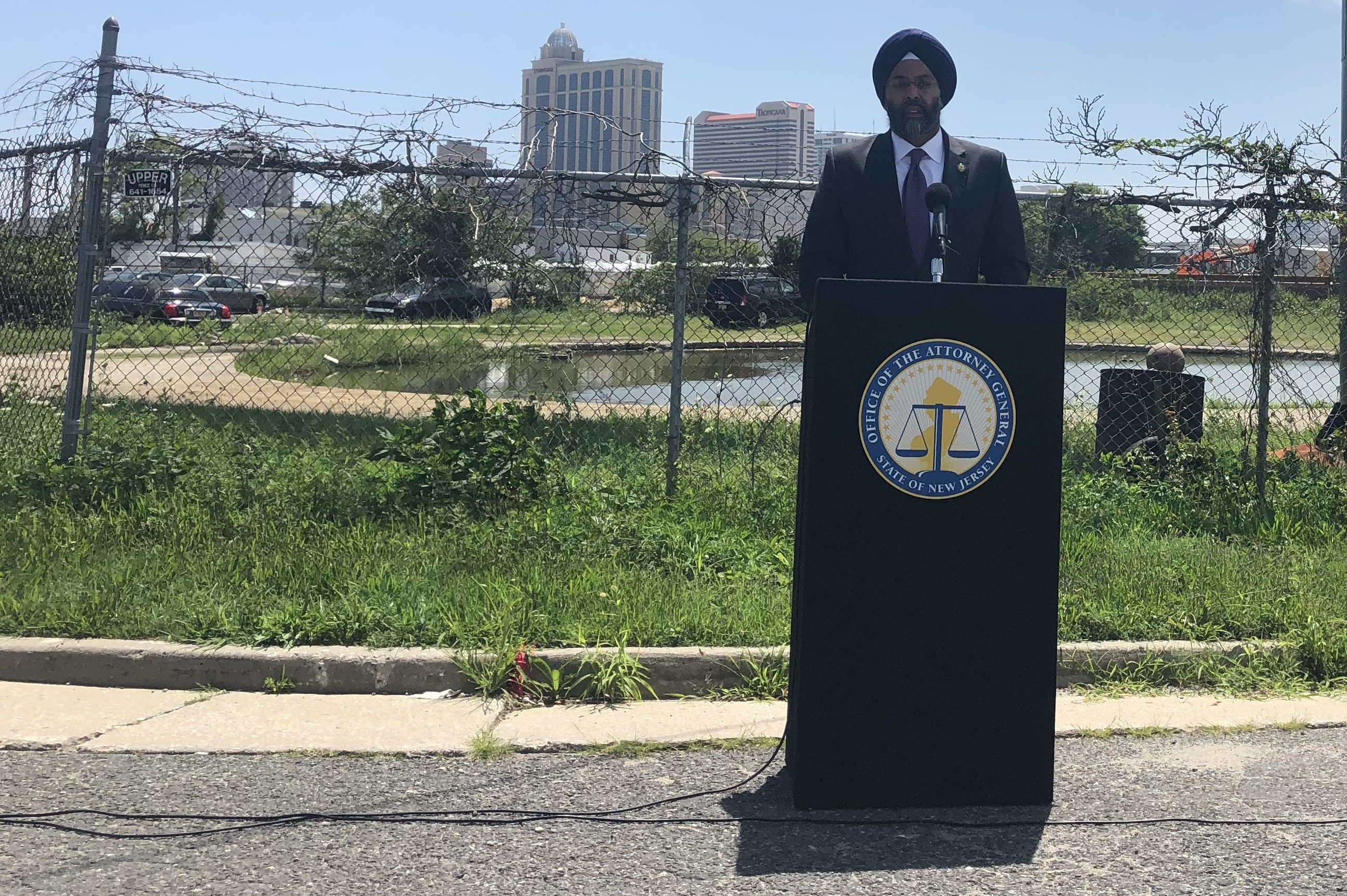 New Jersey Attorney General Gurbir Grewal in front of the Deull Fuel Company manufactured gas plant site, near the Beach Thorofare. waterway in Atlantic City