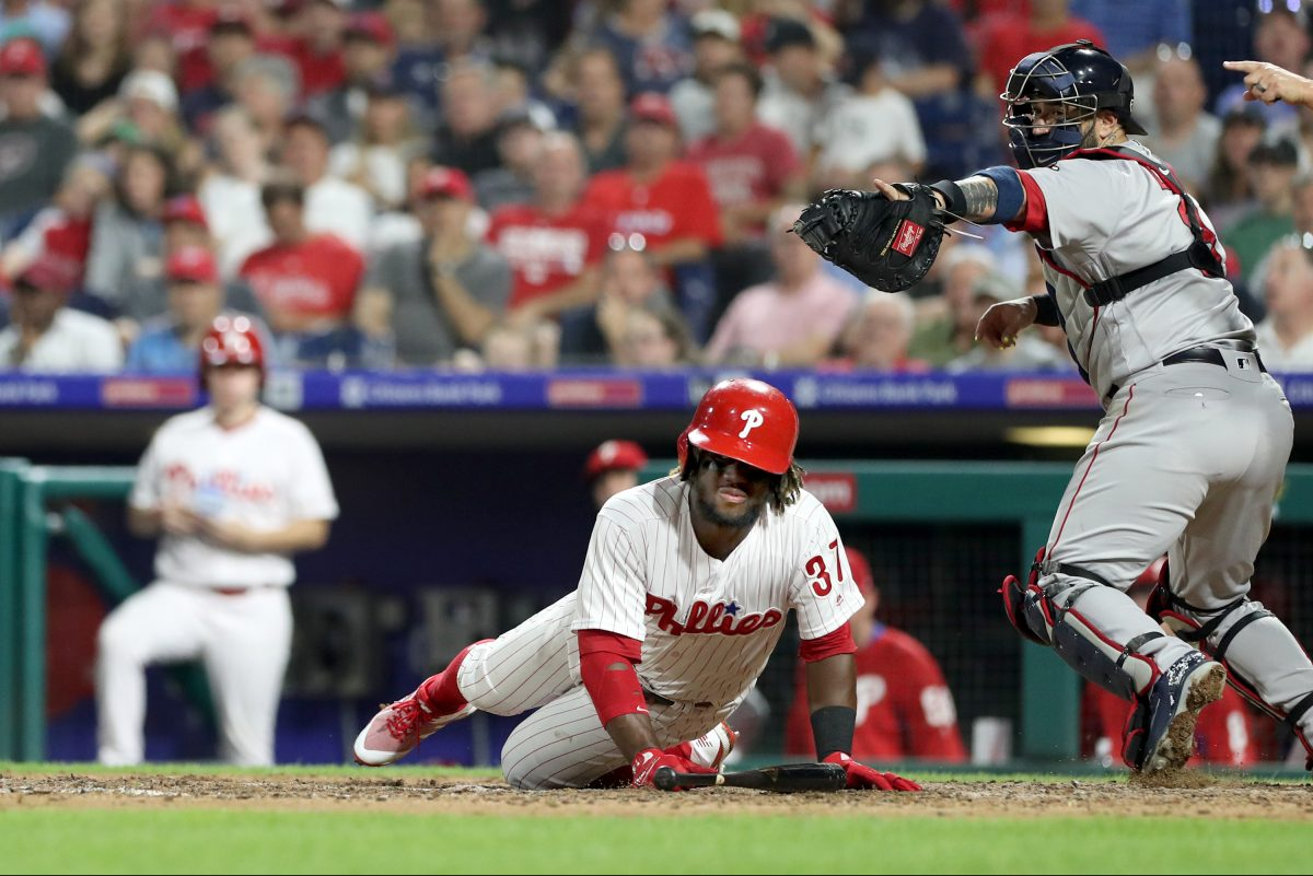 Odubel Herrera falls to the ground after striking out in the eighth inning against the Red Sox Tuesday.