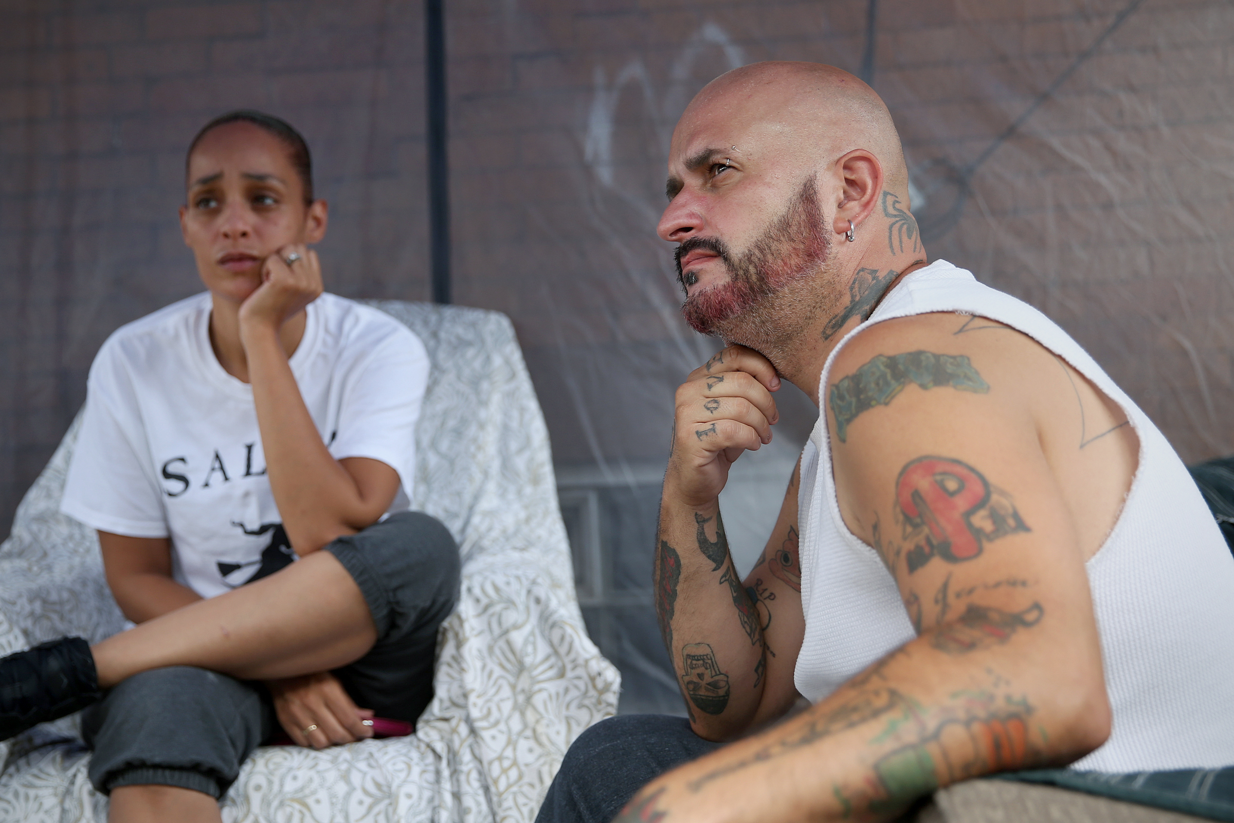 Sitting outside their Port Richmond home on Thursday, Aug. 2, Jennifer Tart, left, and her husband, Jason Rash, recounted the horror Wednesday when pit bulls attacked a toddler inside another home on their block.