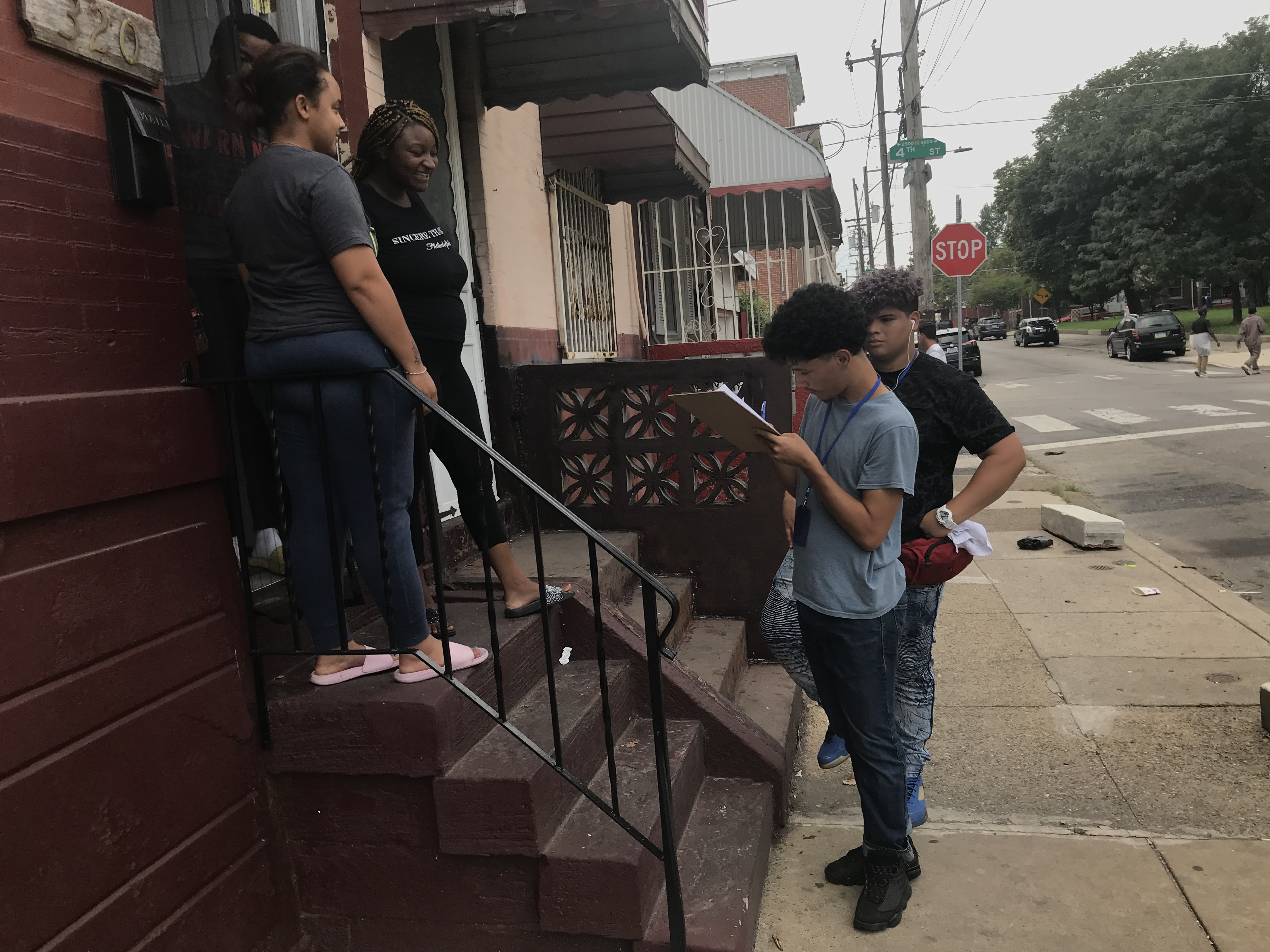 Yariel Nieves, left, and CrisJoel Morales, right, participate in a leadership program at Providence Center, conducting a neighborhood survey about neighborhood trees.