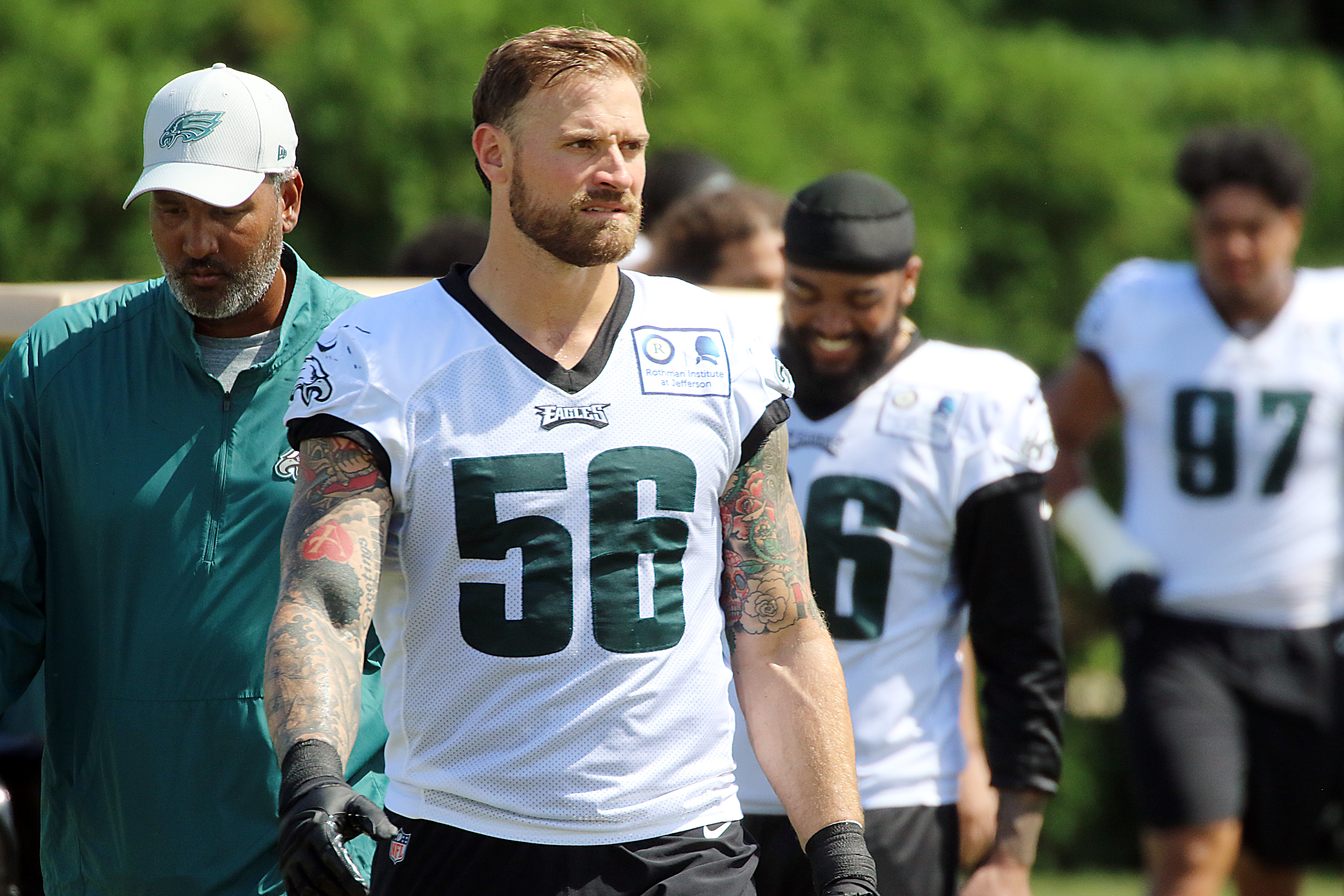 Chris Long walks back to the locker room after practice.