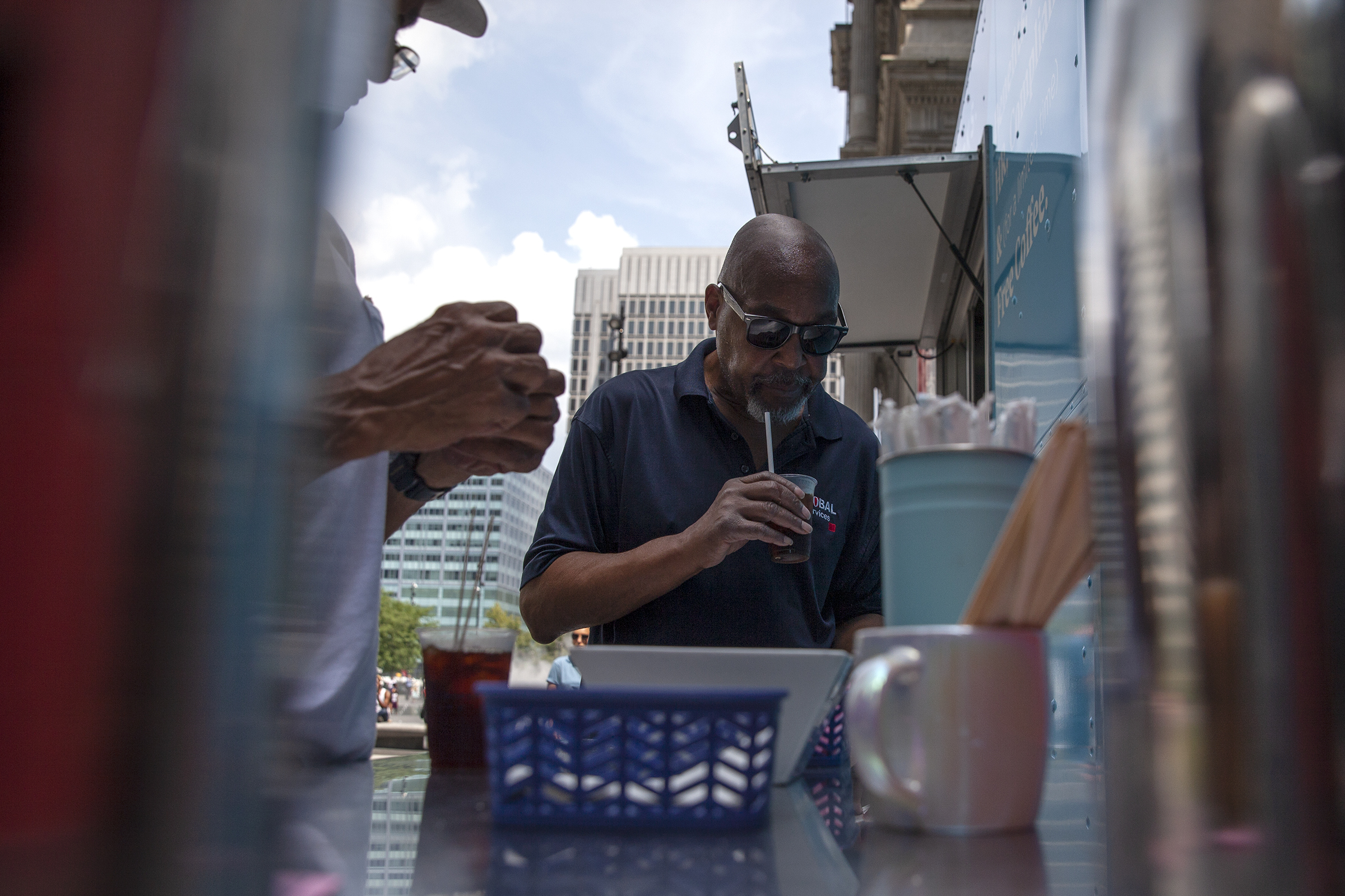 "Gregory Anderson, 61, sips his free coffee from the Justworks truck at Dilworth Park. He saw the truck´s colors ""so curiosity kicked in,"" but learned ""really not too much"" about what the company does, said the maintenance man for Verizon."