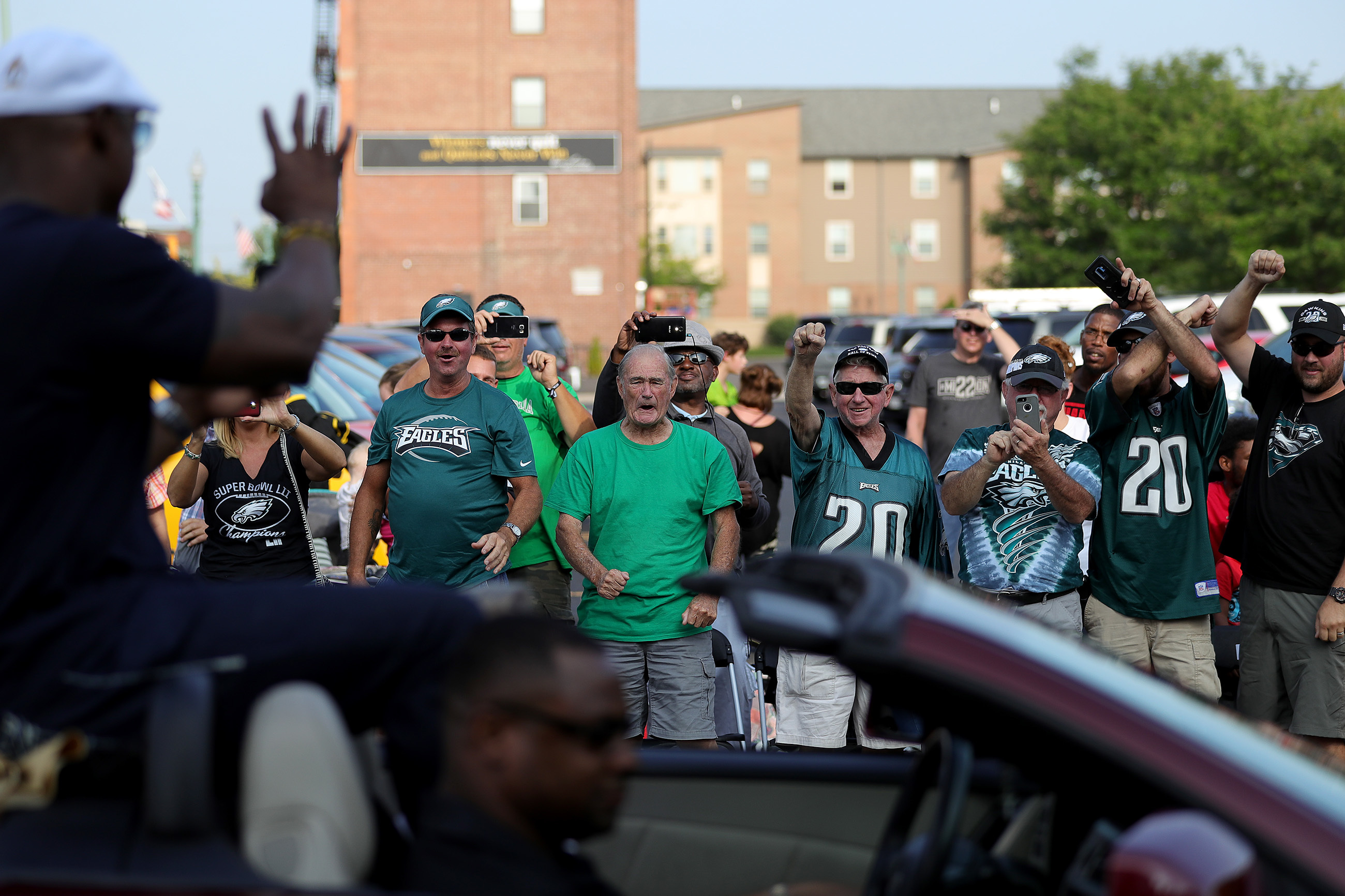 Eagles fans celebrate Brian Dawkins as he parades through Canton, Ohio, ahead of his Hall of Fame enshrinement ceremony.