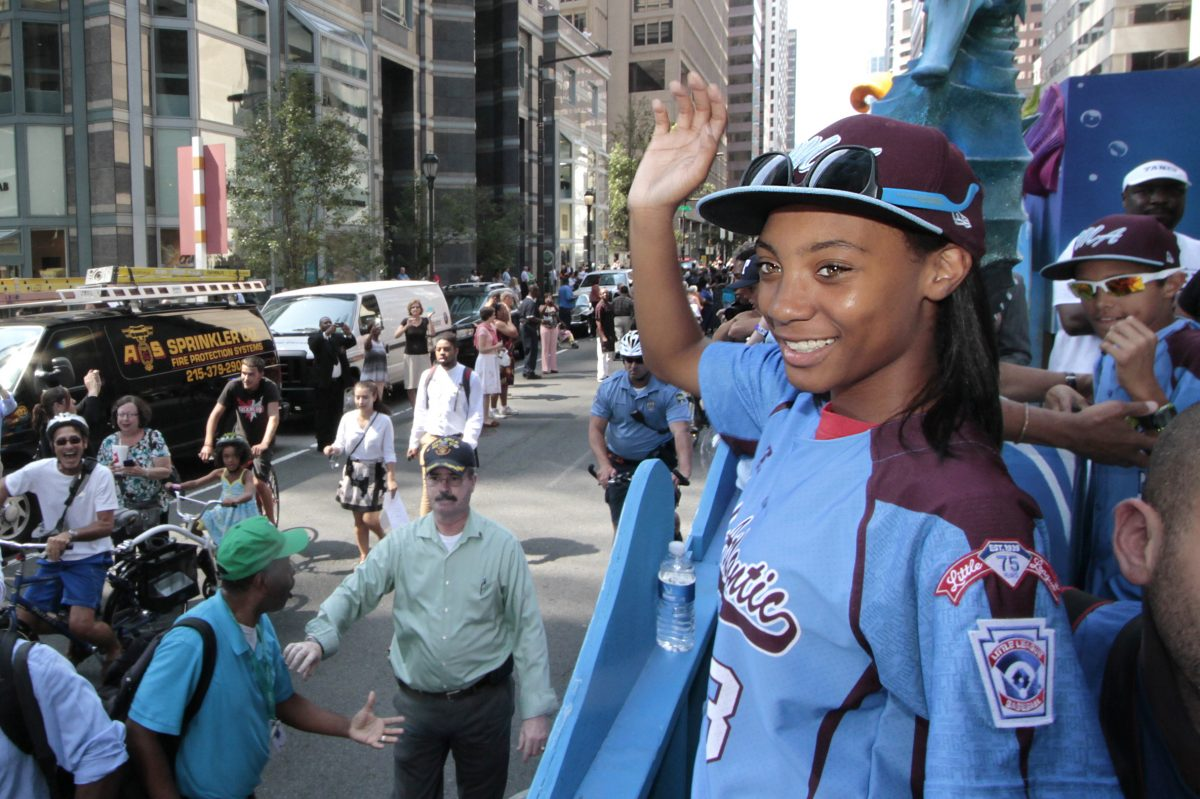 Mo'ne Davis waves to the crowds during the parade for the Taney Dragons in Phila. on Aug. 27, 2014.