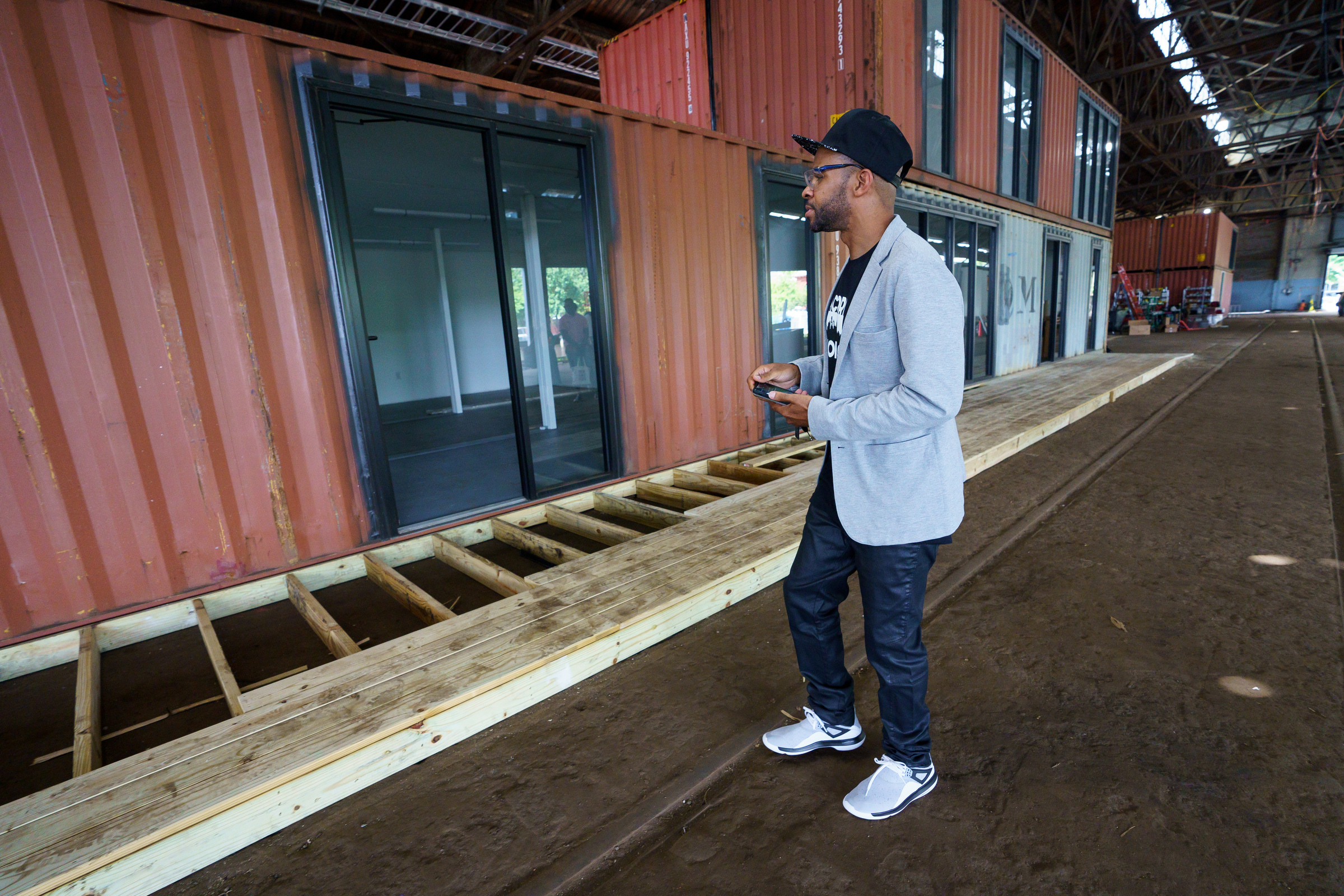 Doll Artist Cori Shepherd checks out the new studio spaces under construction at the Cherry Street Pier, Wednesday, August 22, 2018. He will have a studio space there once the area is officially open.