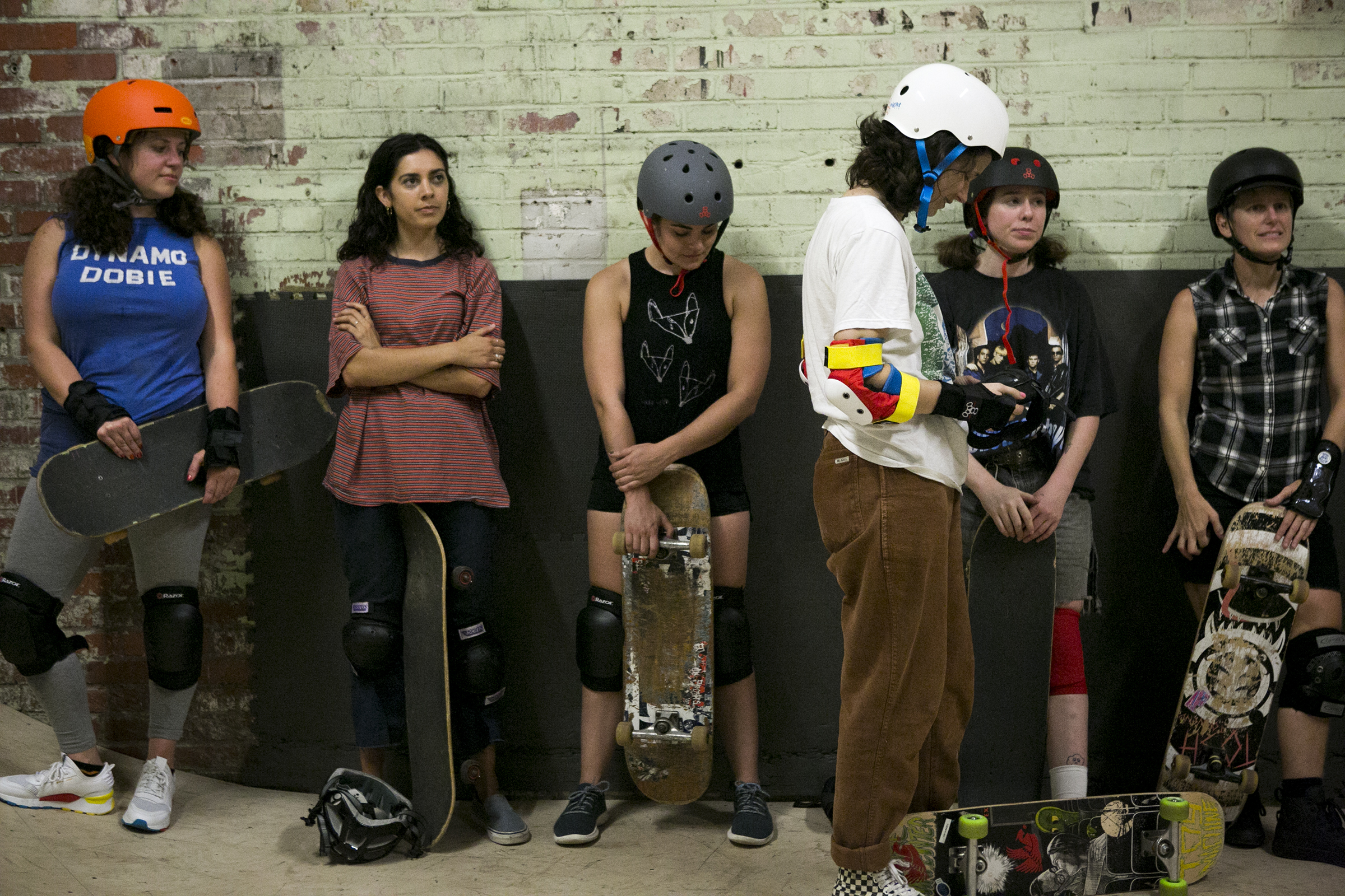 Adult skateboarding students wait for their turn on the halfpipe at Skate the Foundry on 40th Street on the morning of Saturday, August 11, 2018.
