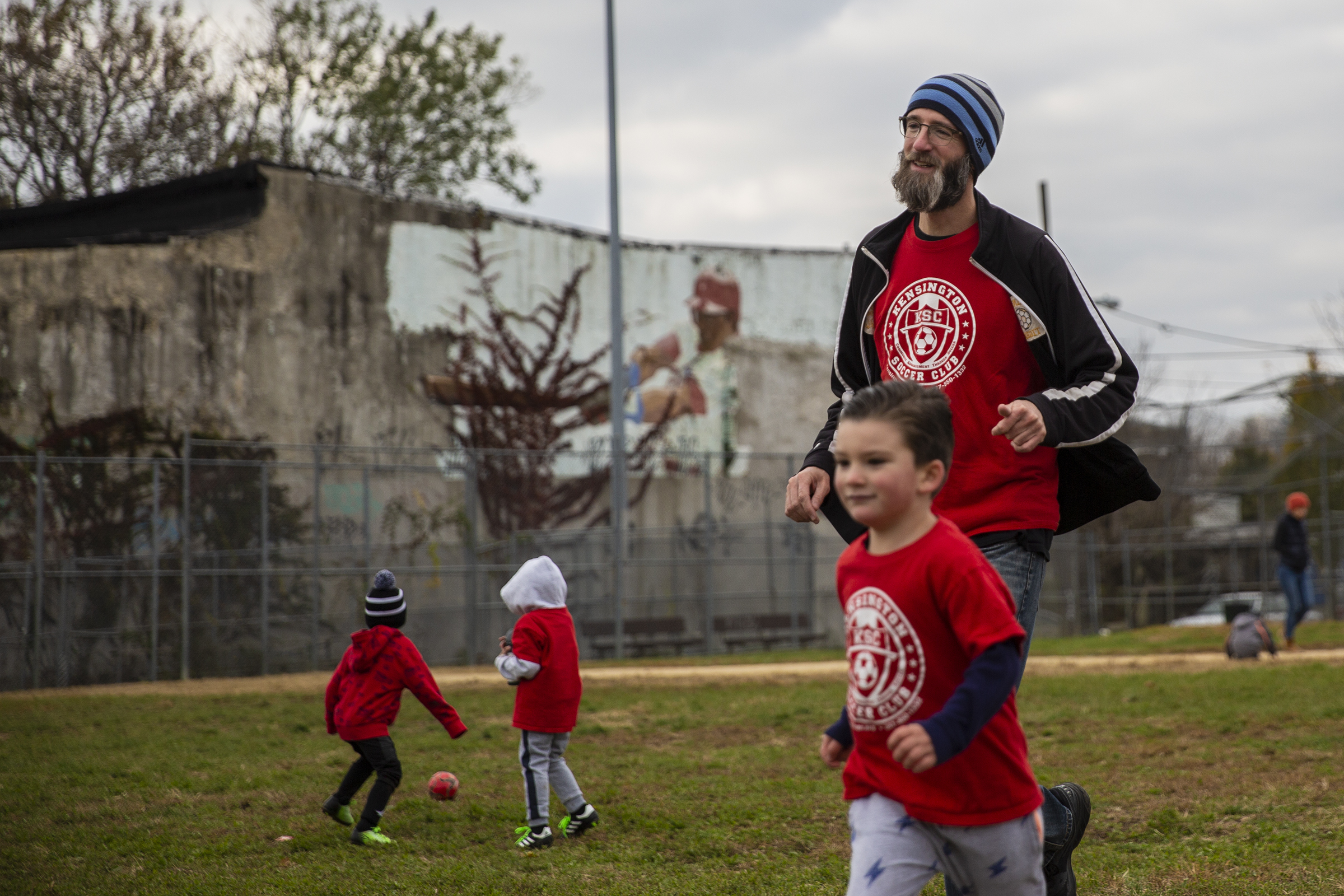 Jim Hardy, founder of the Kensington Soccer Club, plays with a group of children at the conclusion of their soccer practice at the club´s main field at 3rd and Dauphin.