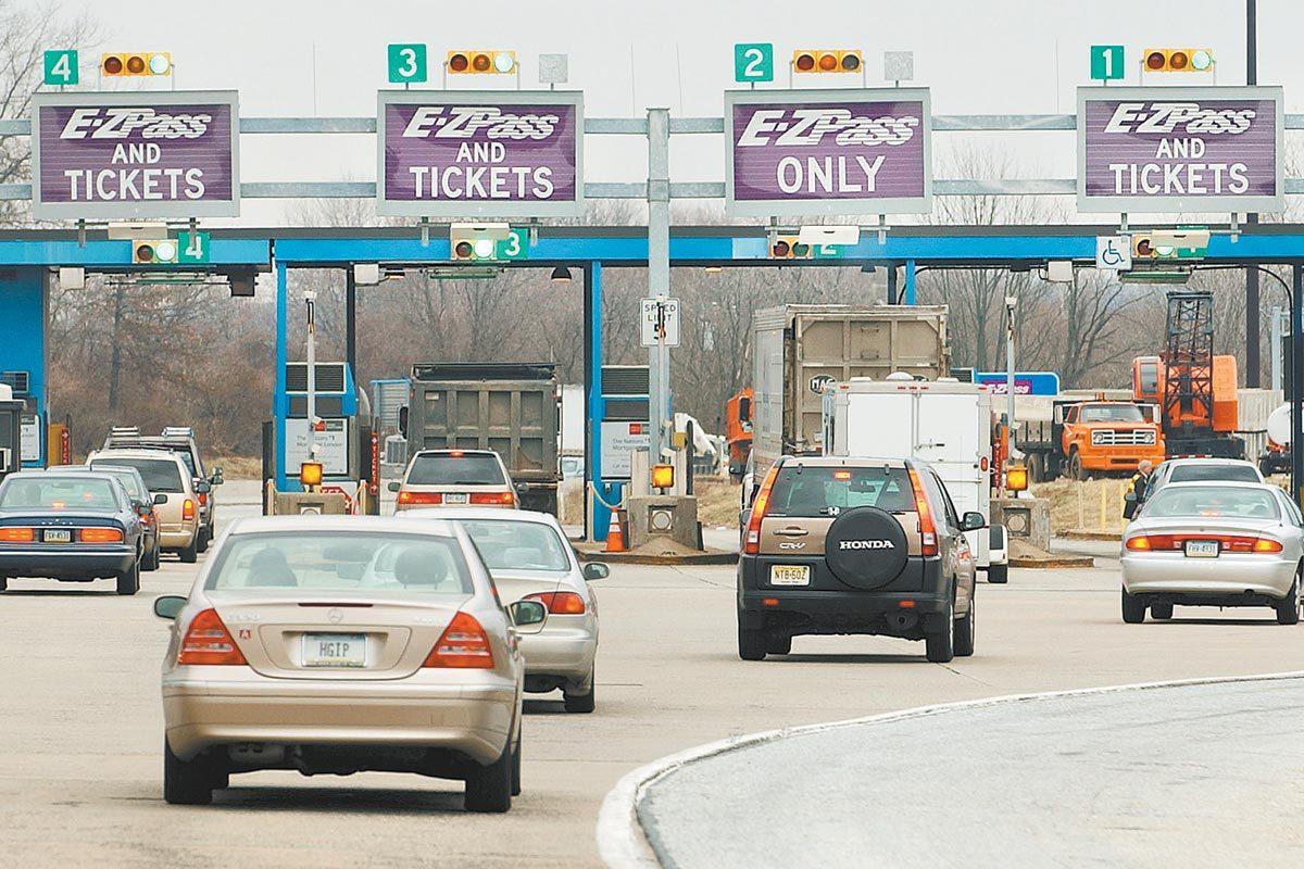 Automobiles drive into the Fort Washington Interchange of the Pennsylvania Turnpike.