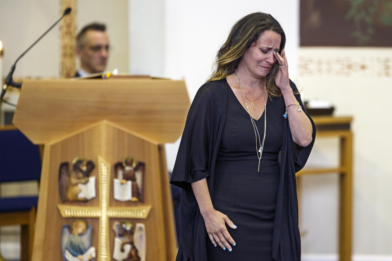 Kathryn Sherlock wipes away tears after speaking at her daughter, Kayden Mancuso´s funeral at St. John the Evangelist Catholic Church.