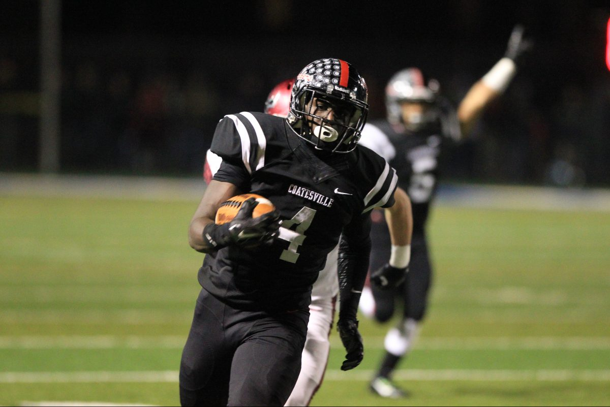 Coatesville Aaron Young runs for a long gain against St. Joseph's Prep in last season's PIAA Class 6A semifinal.