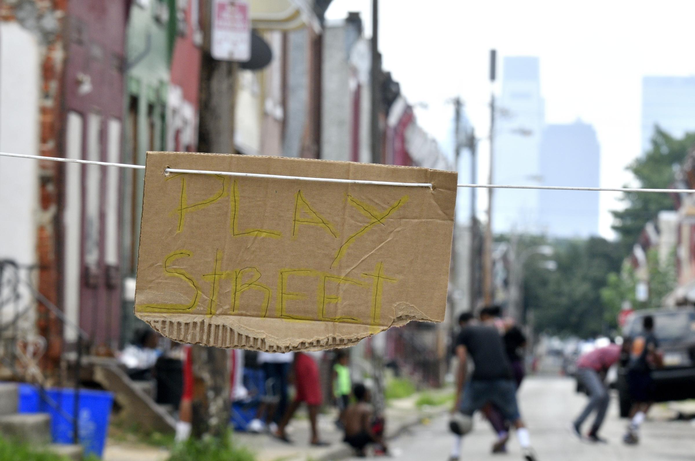 Small card board sign found on the north side of 2400 block of N. Bouvier Street, in North Philadelphia, PA, on August 7, 2018.