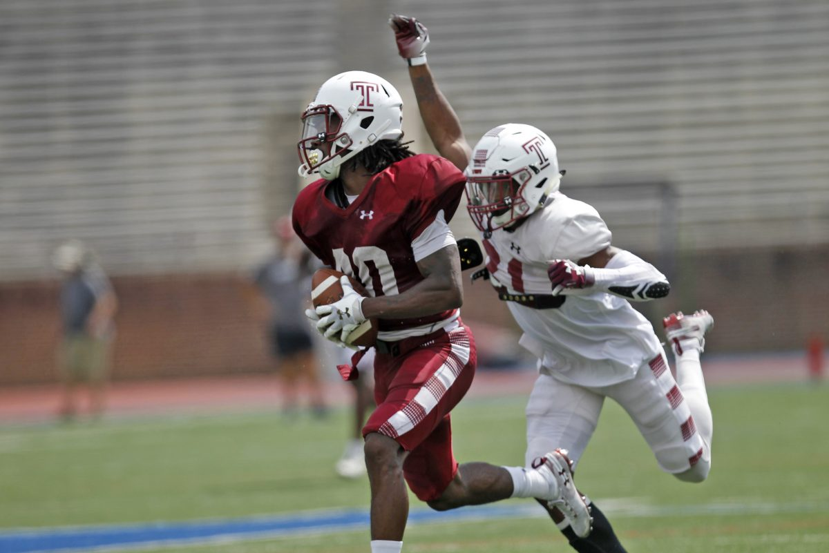 Temple's Freddie Johnson left and Ty Mason during a team scrimmage at Franklin Field on Saturday.