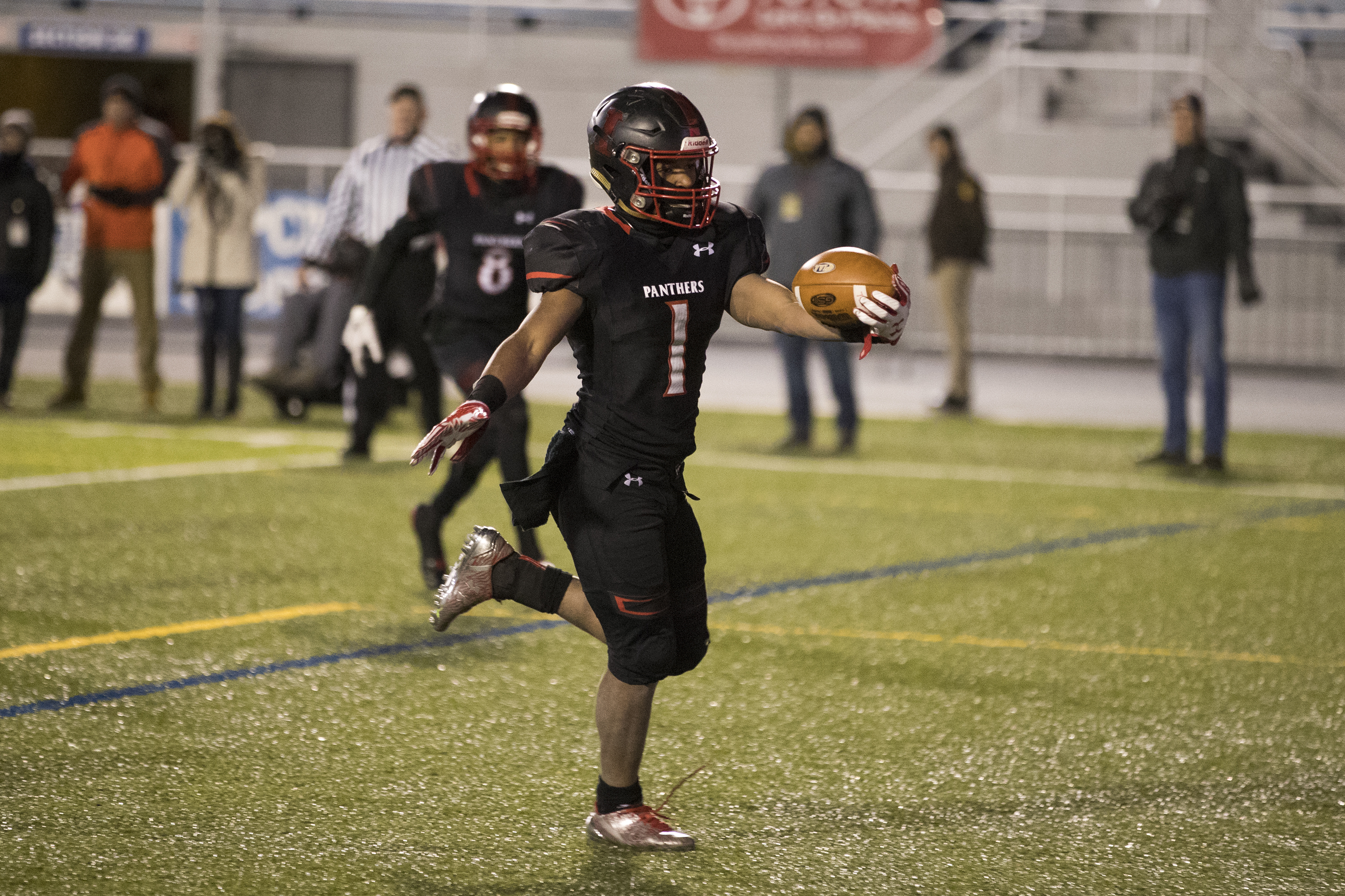 Imhotep Charter´s Carl Jones (1) scores a touchdown in last year´s PIAA Class 4A state final vs. Erie Cathedral Prep.