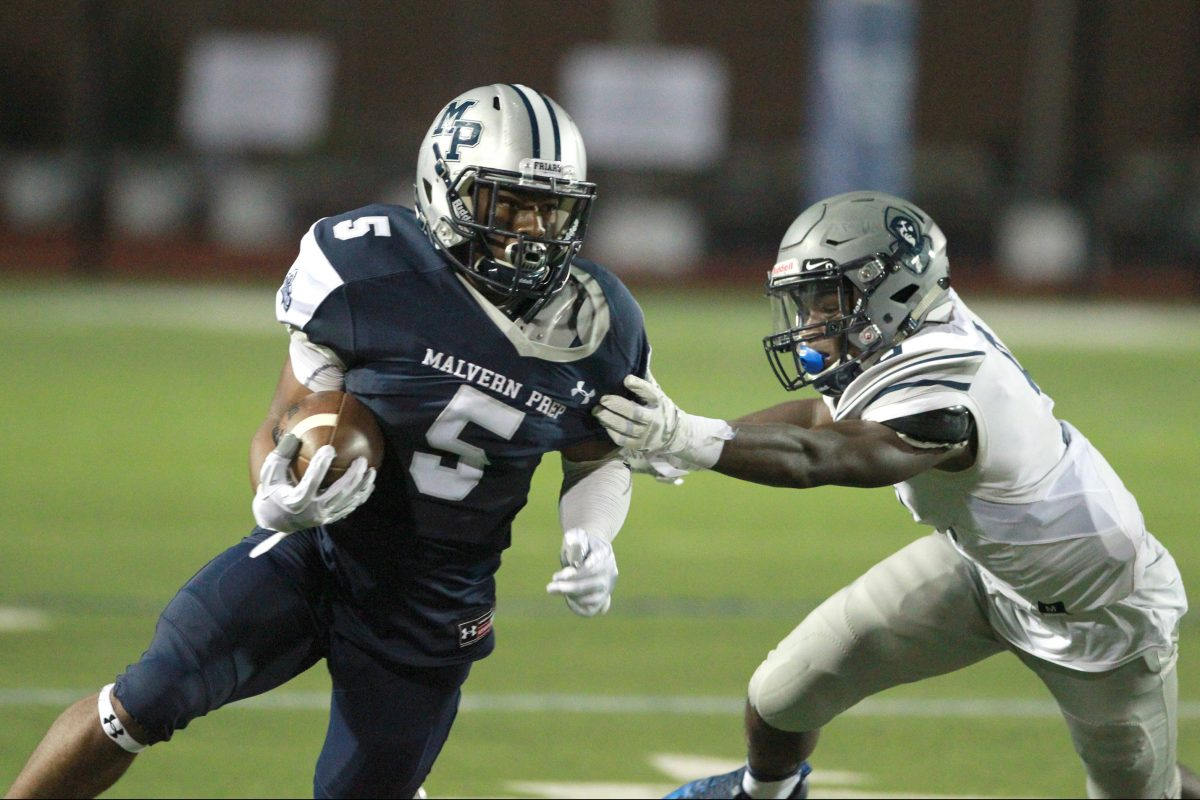 Malvern Prep's Quincy Watson (5) breaks away from the grasp of  St. Augustine Prep's Jaylen DeCoteau in last season's opener.