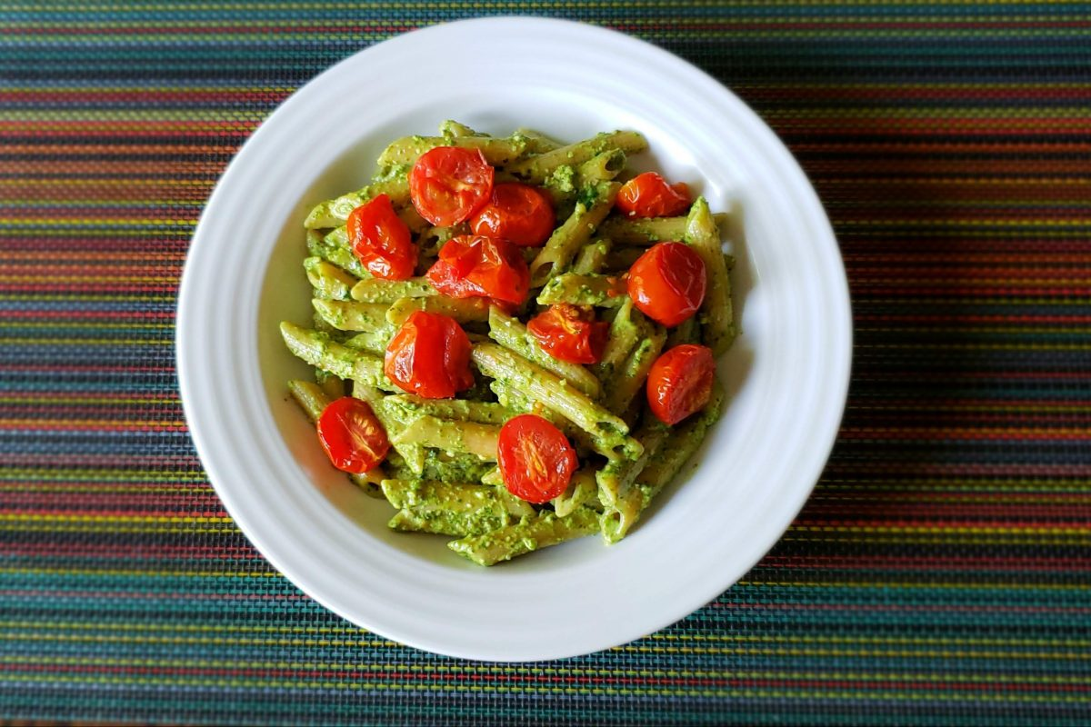 Peruvian pesto with penne and roasted tomatoes.