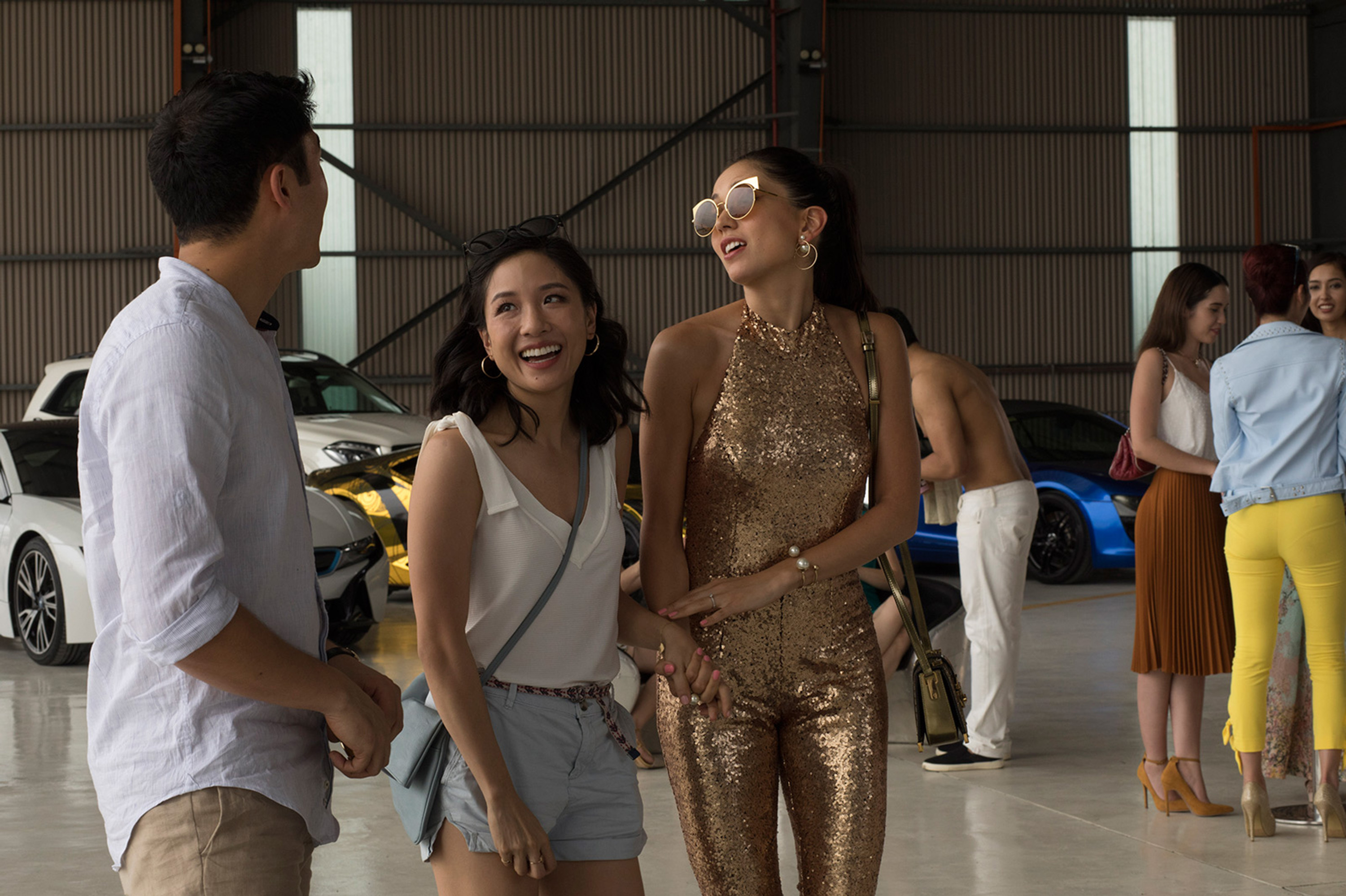 """Henry Golding left), Constance Wu and Sonoya Mizuno in """"Crazy Rich Asians"""""""