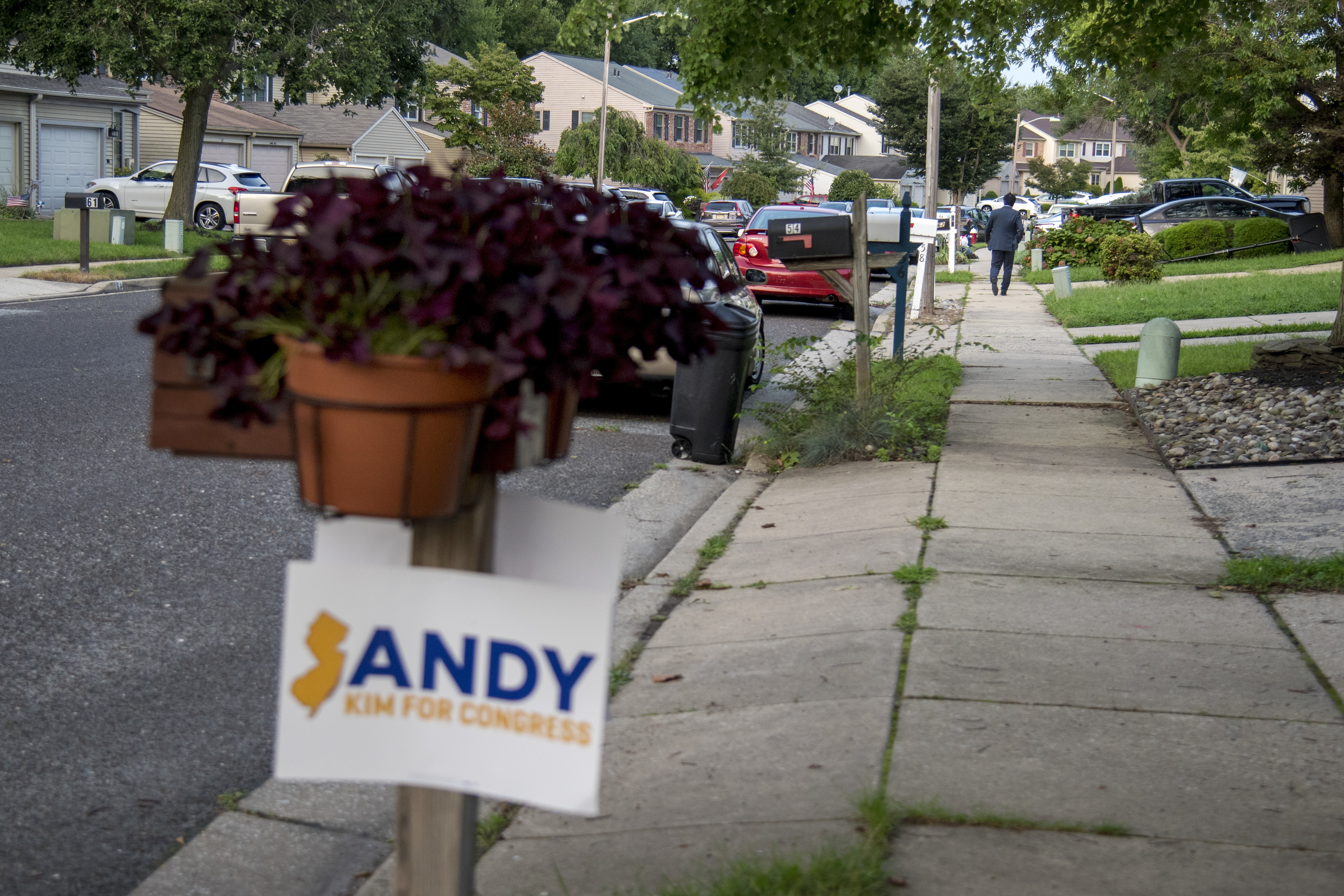 Andy Kim (rear) walks to his car - parked far down the street - after the attended a speaks a fundraiser at a supporter´s home in Mt. Laurel August 20, 2018. A Democrat, Kim is campaigning in the competitive Second Congressional District challenging Republican incumbent U.S. Rep. Tom MacArthur.
