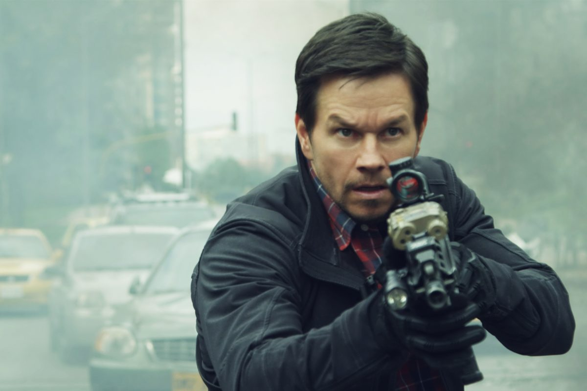 """This cover image released by STXfilms shows Mark Wahlberg in a scene from """"Mile 22."""""""