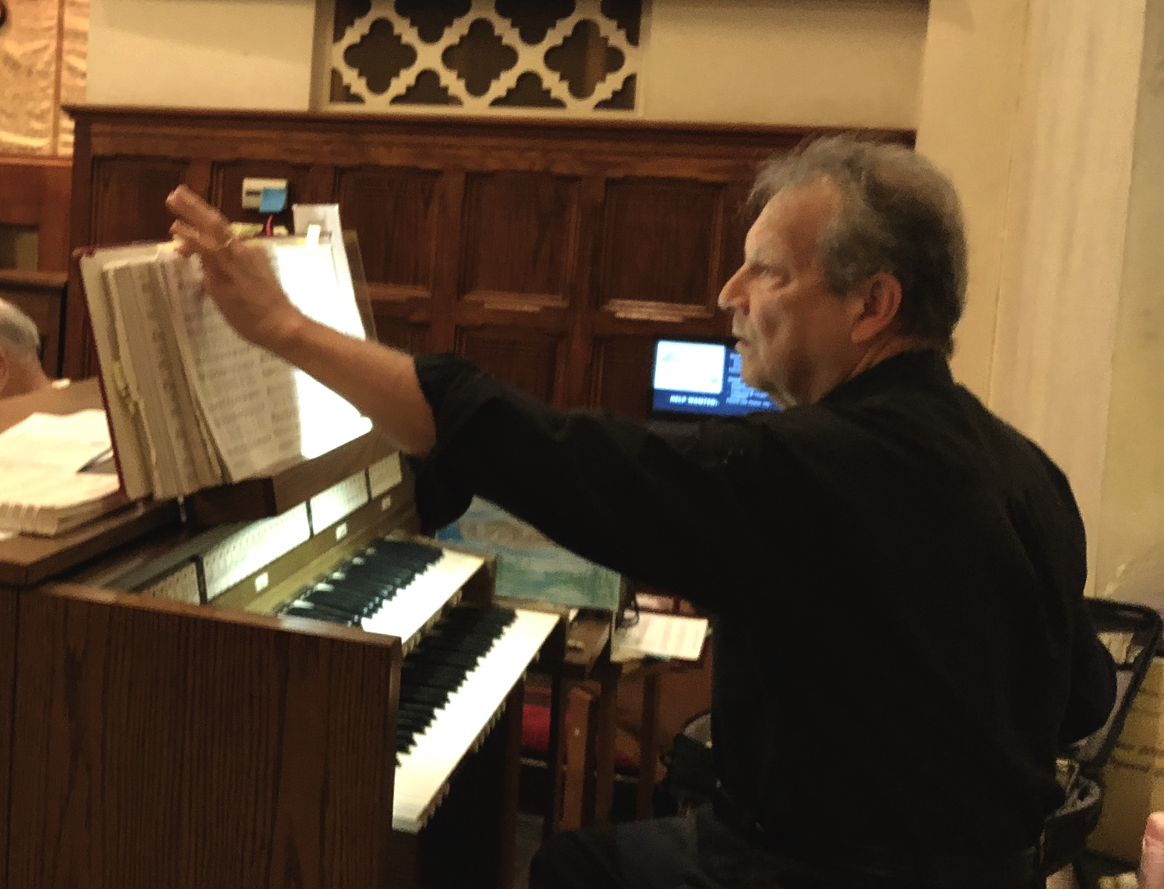 George Akerley prepares his music for a regular Sunday service at St. Mark�s Lutheran Church in Oaklyn, NJ. He began playing in churches at age 15.