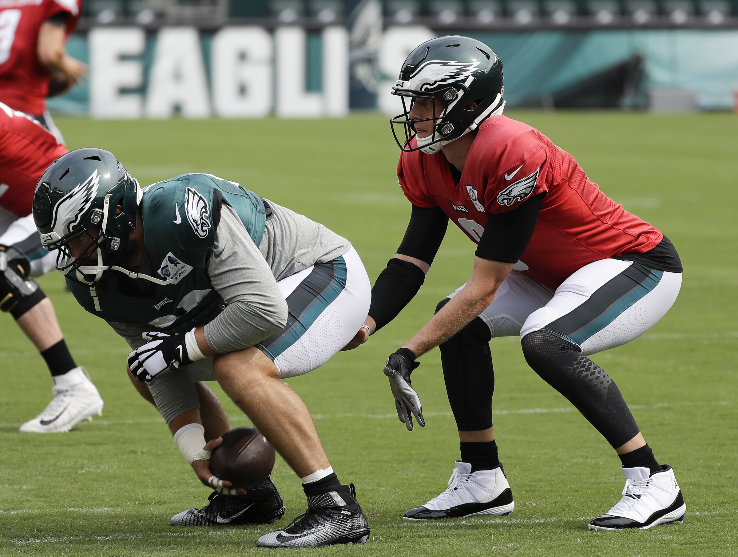 Eagles center Jason Kelce snaps the football to quarterback Nick Foles at Lincoln Financial Field in South Philadelphia on Saturday, August 11, 2018. YONG KIM / Staff Photographer