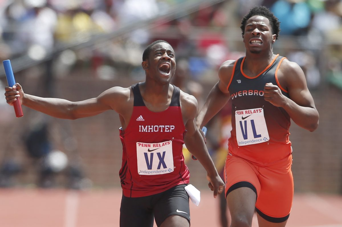 Kristian Marche, left, of Imhotep edges out Clifford Brinkley of Overbrook in the High School Boys' 4x400m Philadelphia Public League at the Penn Relays on April 29, 2017, at Franklin Field.