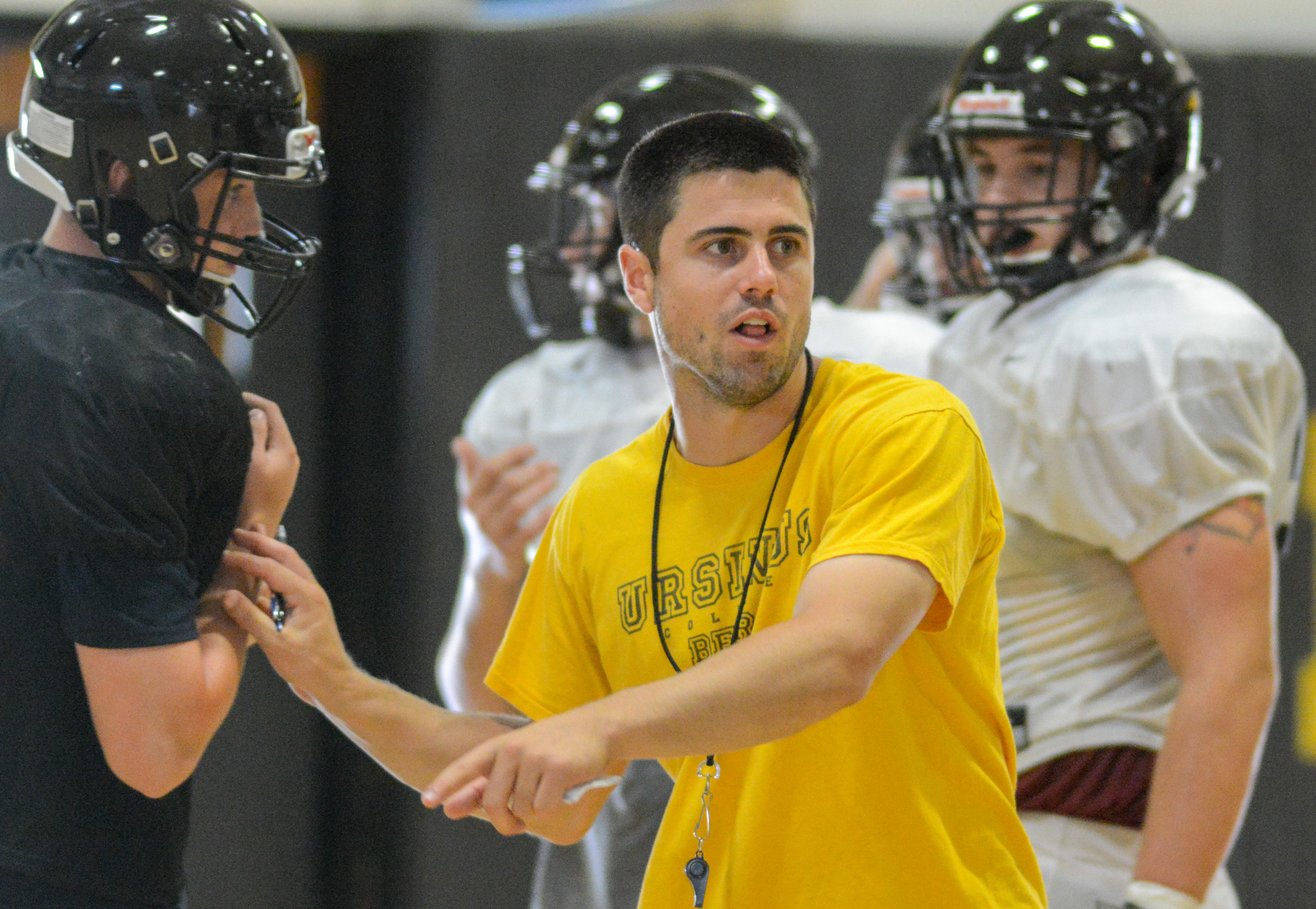 New Archbishop Wood football head coach Kyle Adkins gives direction to his players during practice on Tuesday.