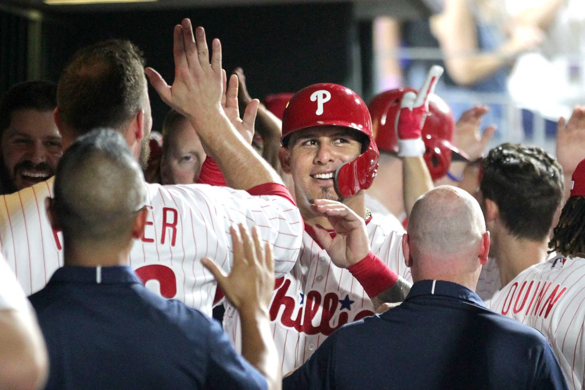 Wilson Ramos, center, of the Phillies is congratulated after scoring in the 6th inning.  Ramos had 3 hits, 3 runs, and 3 RBIÕs against the Red Sox at Citizens Bank Park on August 15, 2018.