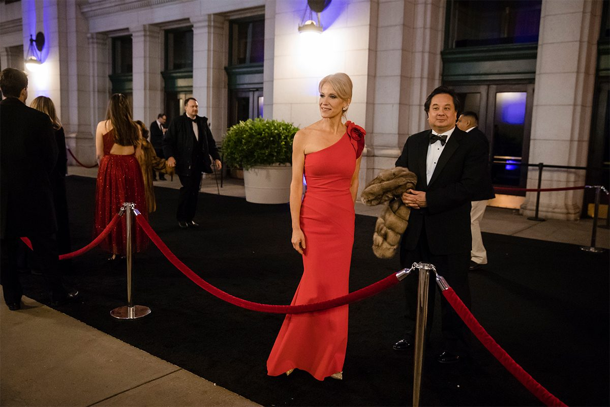 In this Thursday, Jan. 19, 2017 photo, President-elect Donald Trump adviser Kellyanne Conway, center, accompanied by her husband, George, speaks with members of the media as they arrive for a dinner at Union Station in Washington, the day before Trump's inauguration.