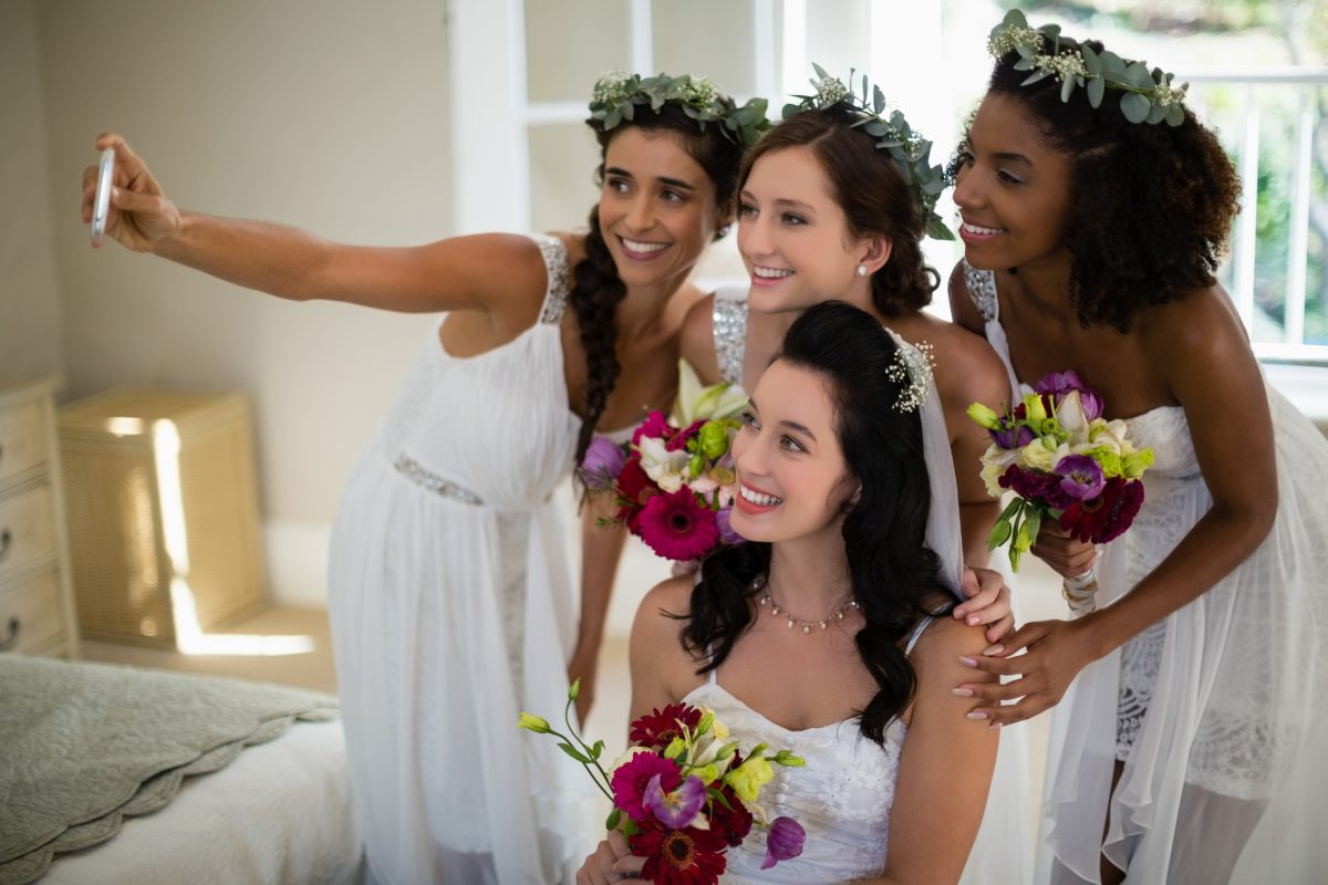 Wedding party members on average spent $1,430 last year to be a part of a close friend or family member's wedding, according to wedding planning site The Knot.