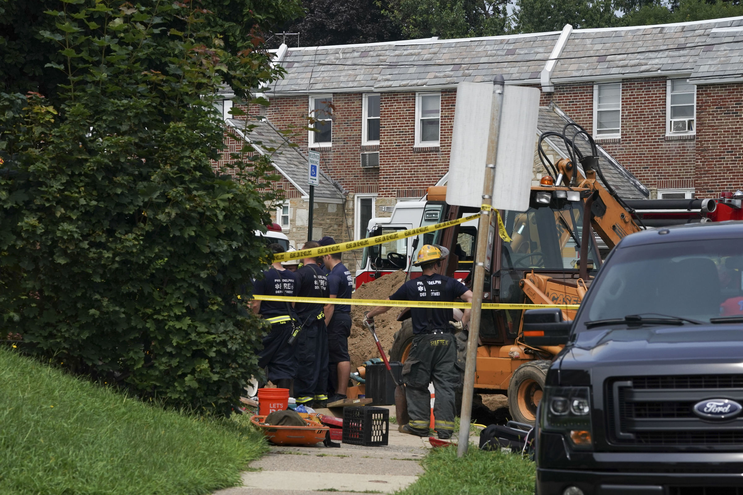 Authorities gather Thursday in the 100 block of West Walnut Park Drive.